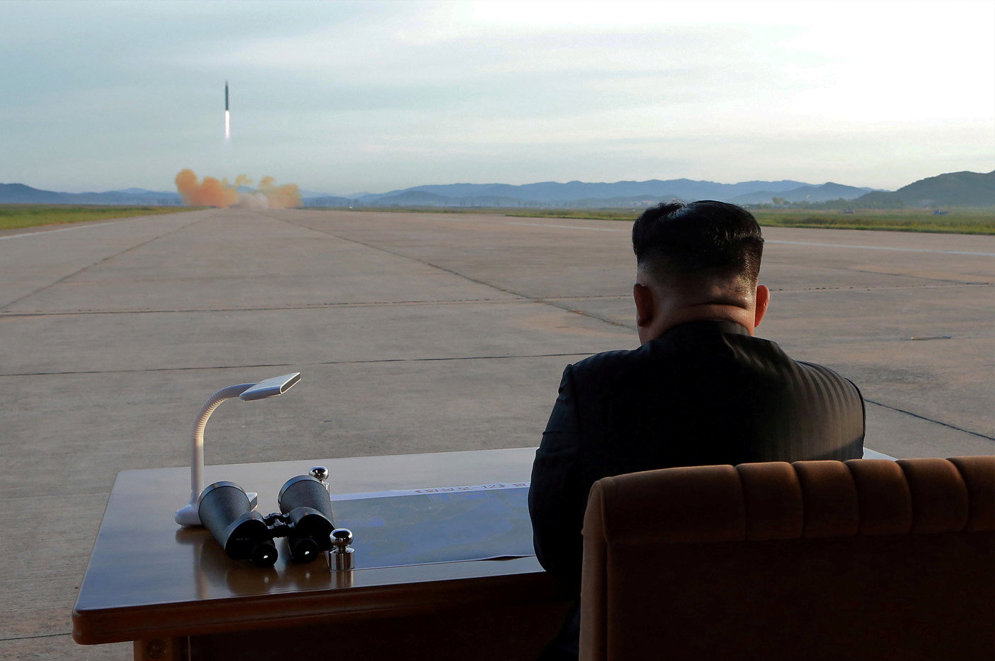North Korean leader Kim Jong Un watches the launch of a Hwasong-12 missile in this undated photo released by North Korea's Korean Central News Agency, Sept. 16, 2017.