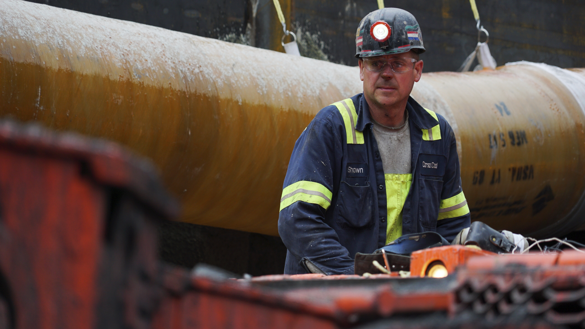 A miner runs a coal continuous miner at a coal mine in Friedens, Pa., June 7, 2017.