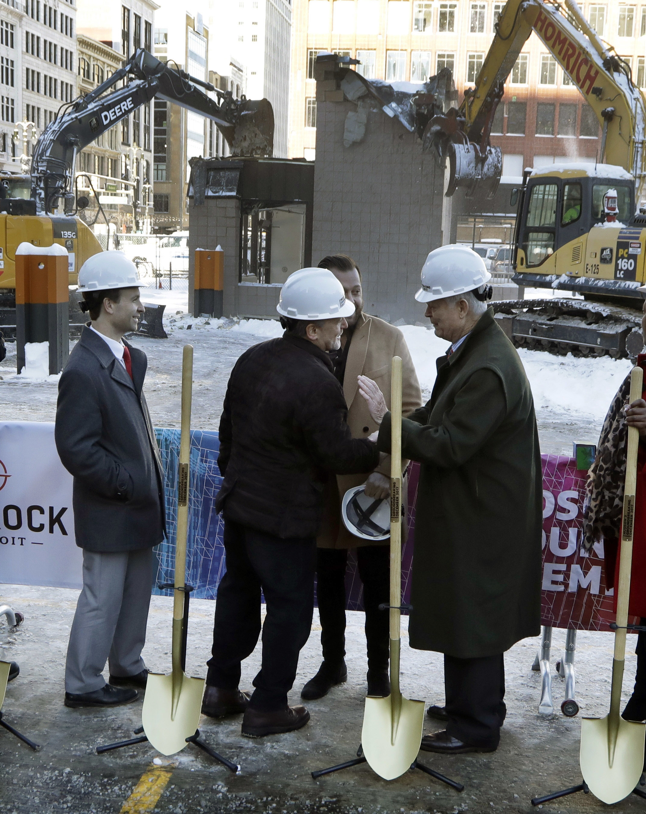 Quicken Loans founder Dan Gilbert, center, meets with Joe Hudson, former CEO of the J.L. Hudson Company at the groundbreaking site of the city's new 800-foot-tall building, Dec. 14, 2017, in Detroit. Bedrock Detroit real estate says the $900 million ...