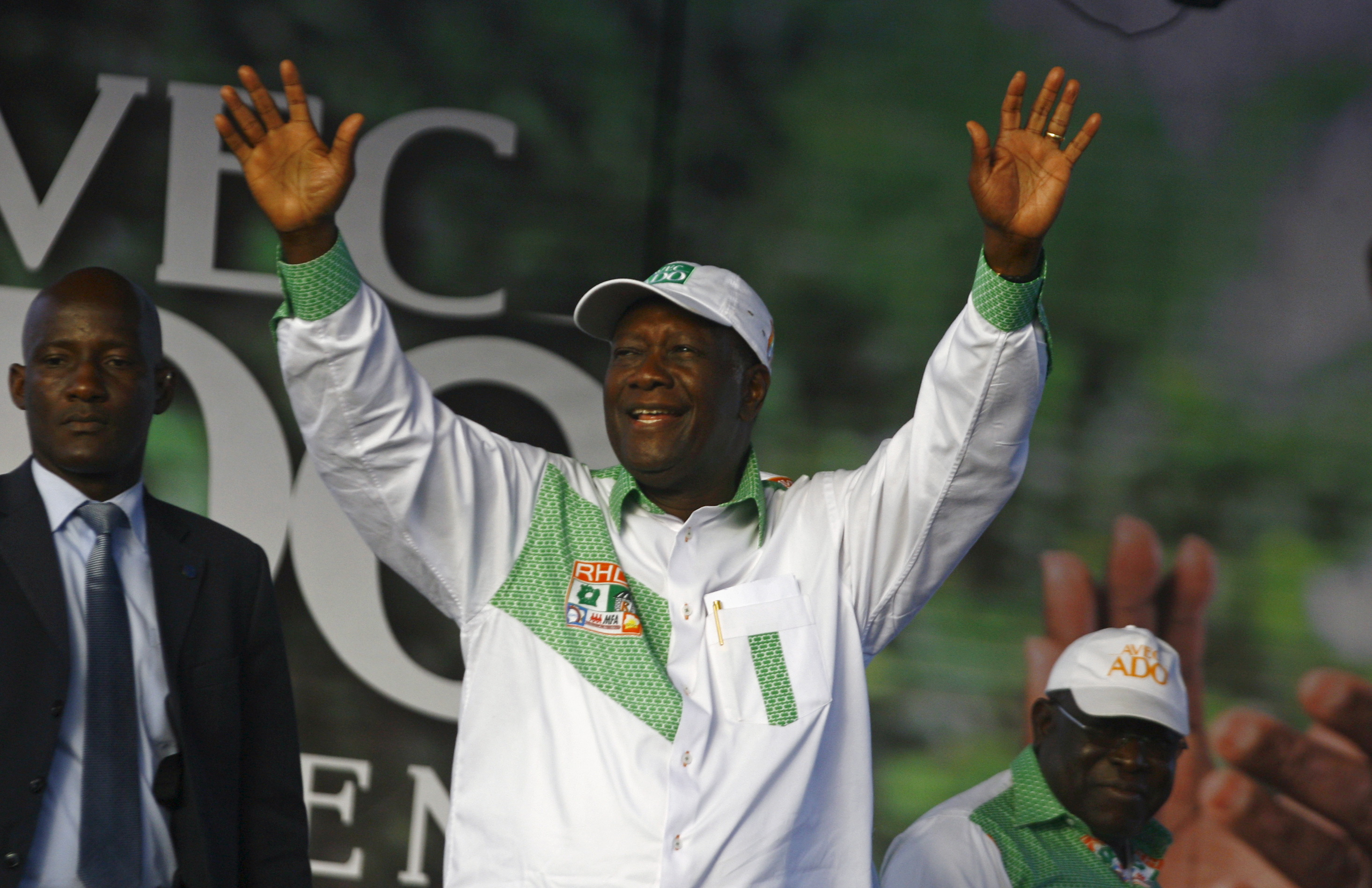 Ivory Coast's President Alassane Ouattara of the Rally of the Houphouetists for Democracy and Peace (RHDP) party waves as he arrives for a campaign rally at the place inch alla in Abidjan, Oct. 20, 2015.