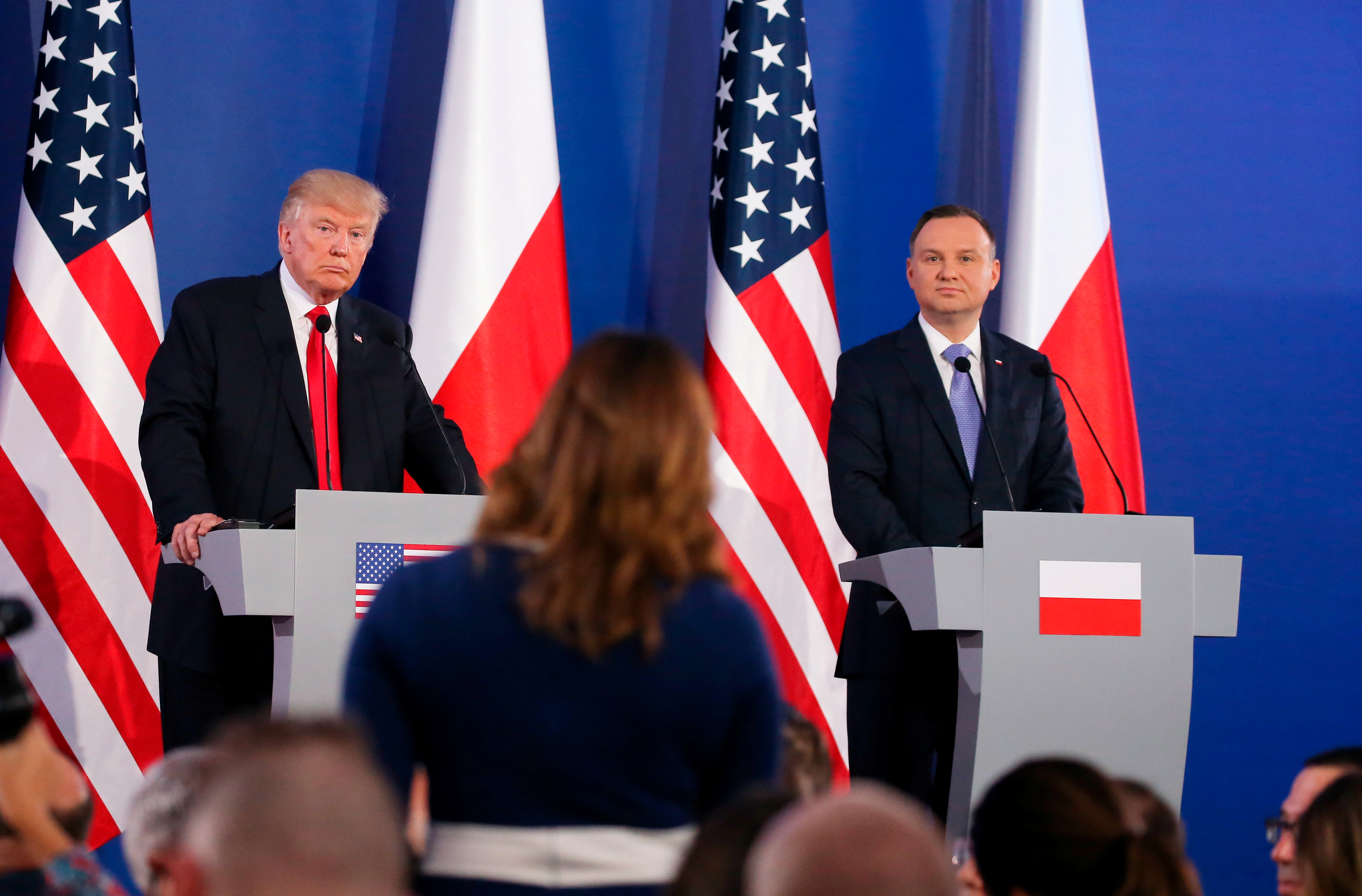 U.S. President Donald Trump and Polish President Andrzej Duda listen to questions from journalists during a joint news conference, in Warsaw, Poland, July 6, 2017.
