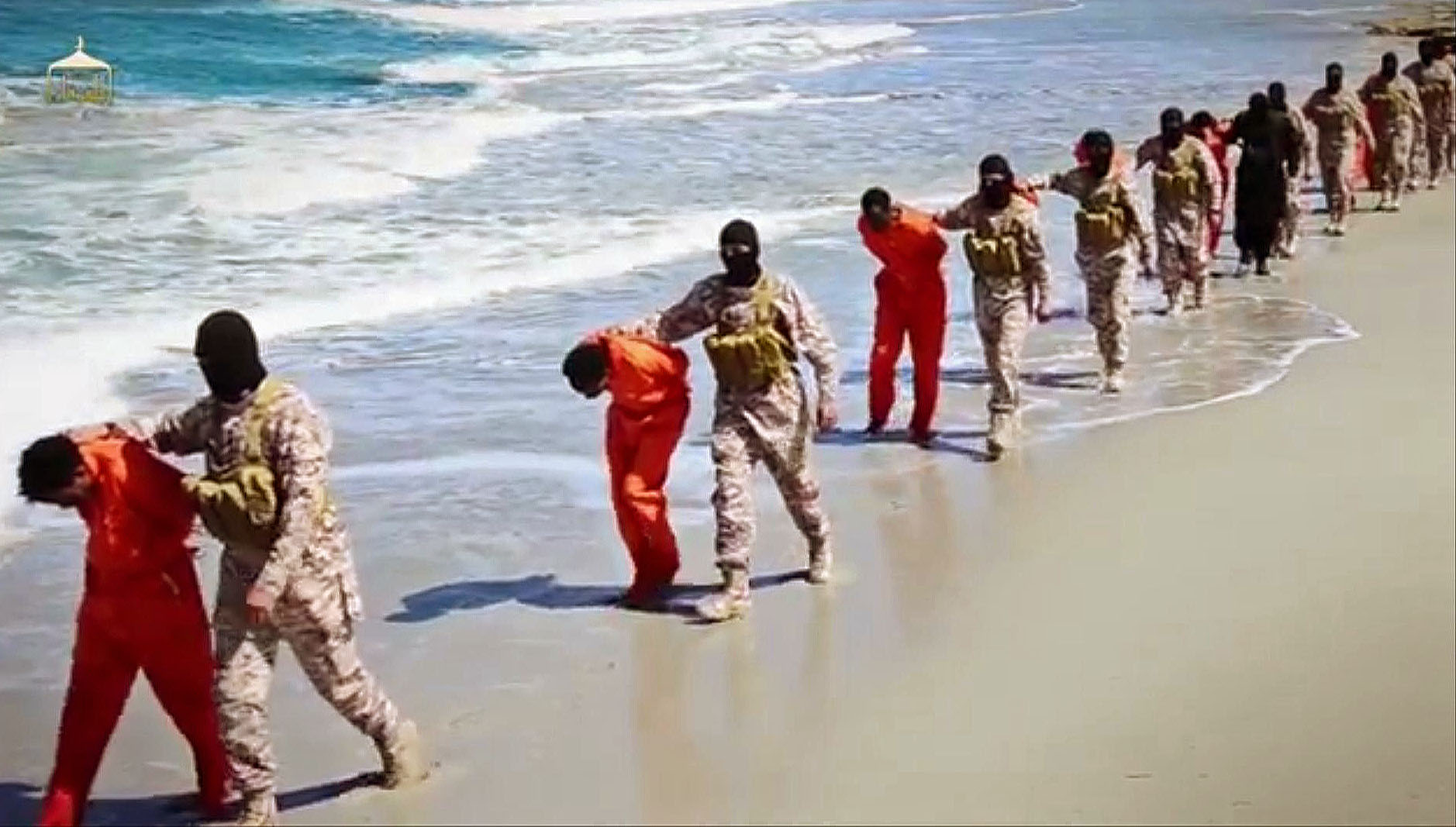 This undated image made from video released by Islamic State militants April 19, 2015, purports to show a group of captured Ethiopian Christians taken to a beach before being executed.