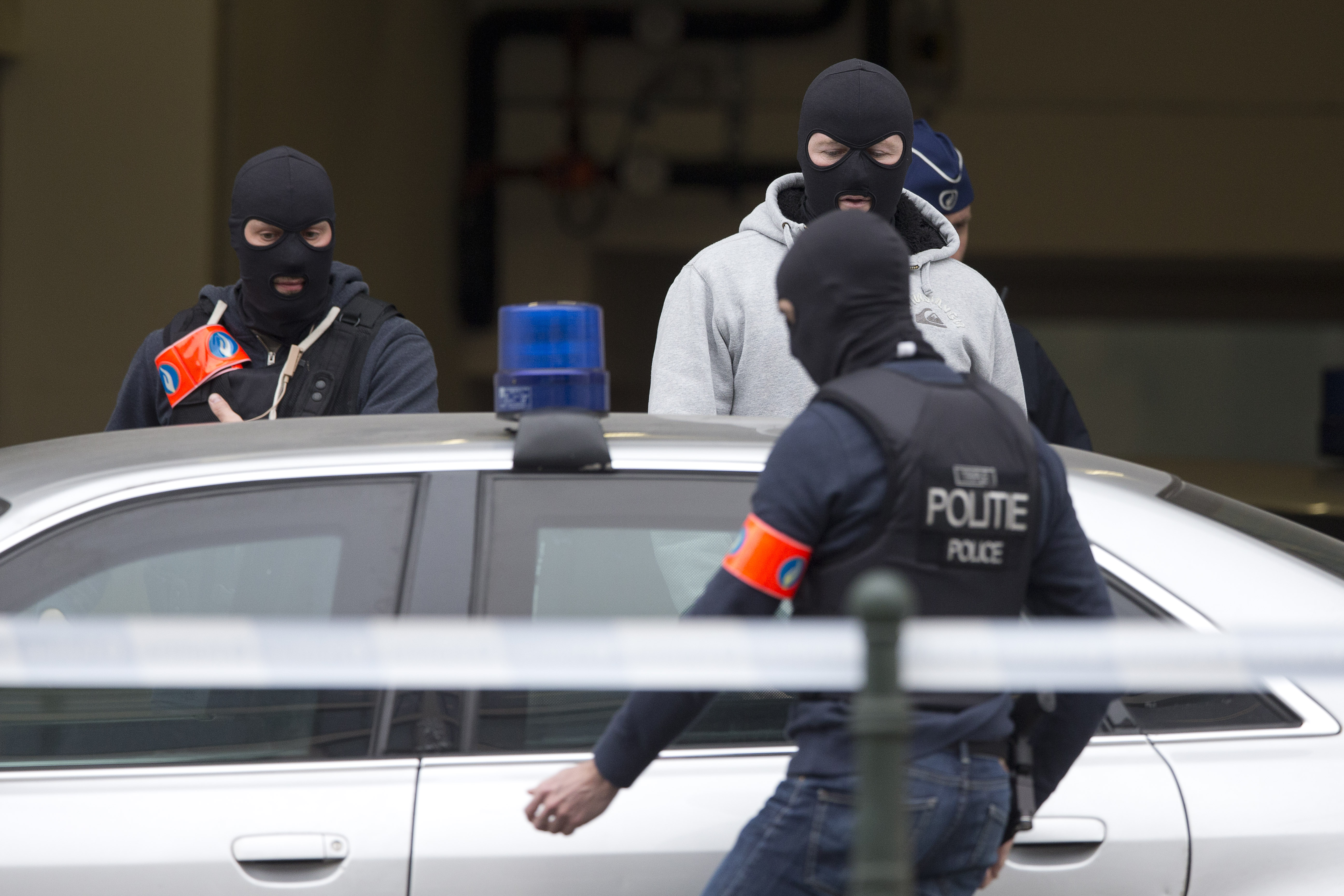 Belgian police officers get into a vehicle outside a court building where Salah Abdeslam, the top suspect in last year's deadly Paris attacks, was expected to appear before a judge in Brussels, Belgium, March 24, 2016.