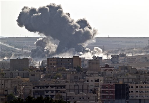 Smoke rises over the Syrian city of Kobani, following a US led coalition airstrike, seen from outside Suruc, on the Turkey-Syria border Monday, Nov. 10, 2014. Kobani, also known as Ayn Arab, and its surrounding areas, has been under assault by extrem...