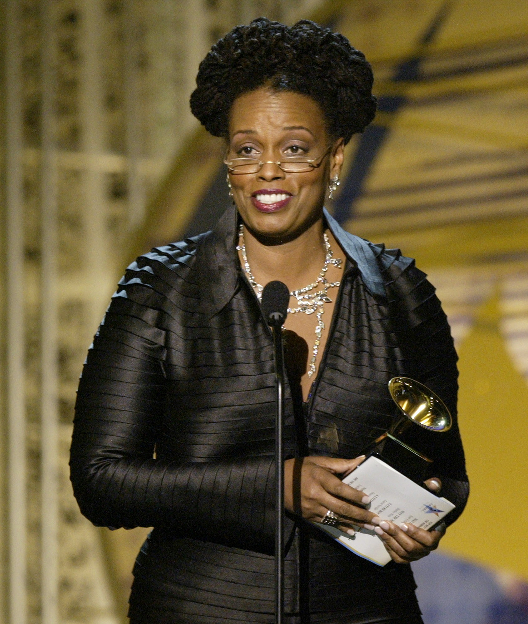 """Dianne Reeves accepts her award for best jazz vocal album for """"A Little Moonlight"""" during the 46th Annual Grammy Awards, Sunday, Feb. 8, 2004, in Los Angeles."""