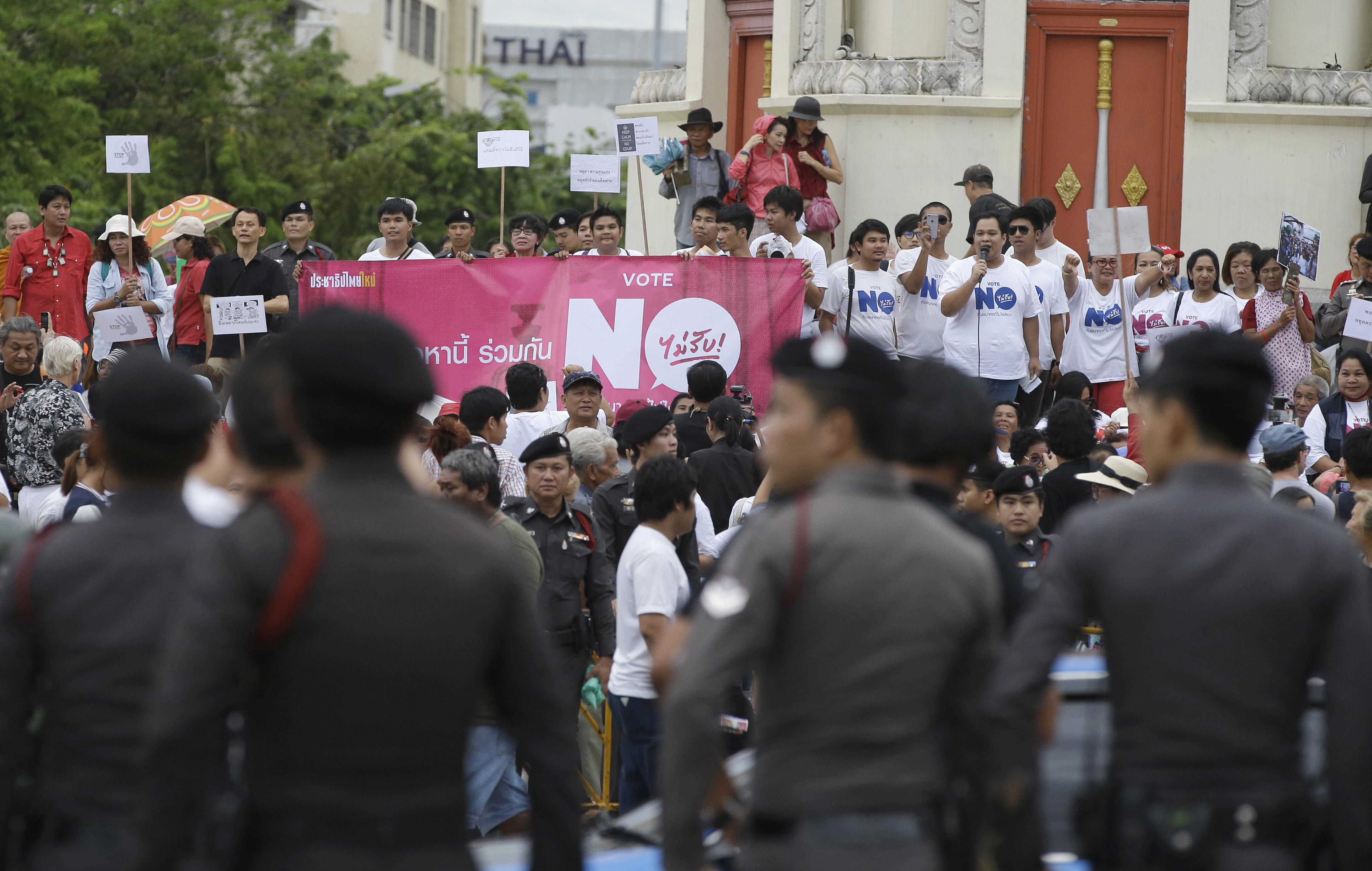 FILE - Police stand watch as anti-coup demonstrators rally to mark the second anniversary of the military takeover of government, in Bangkok, Thailand, May 22, 2016.