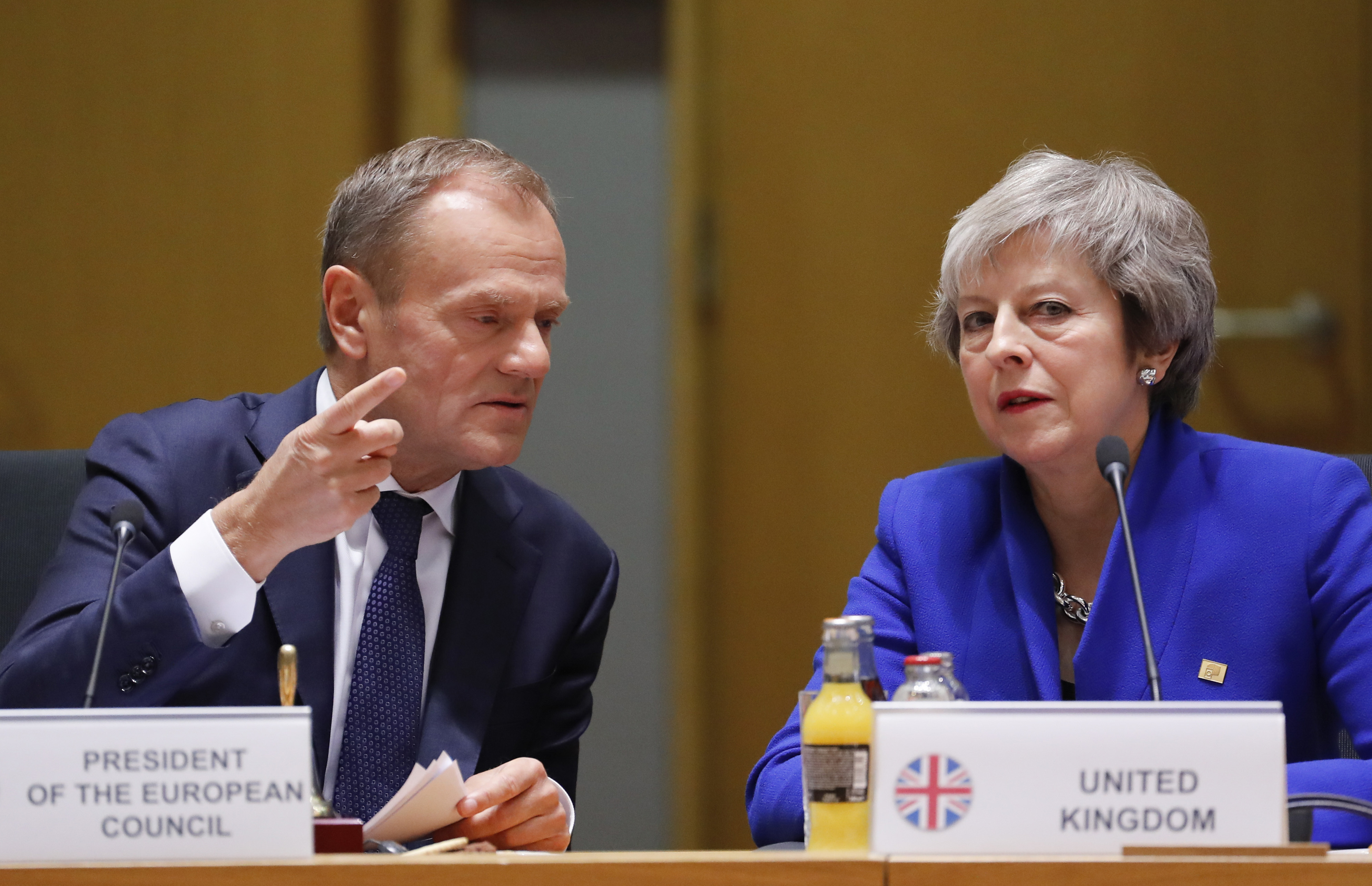 British Prime Minister Theresa May and European Council President Donald Tusk attend a round table meeting at an EU summit in Brussels, Nov. 25, 2018.