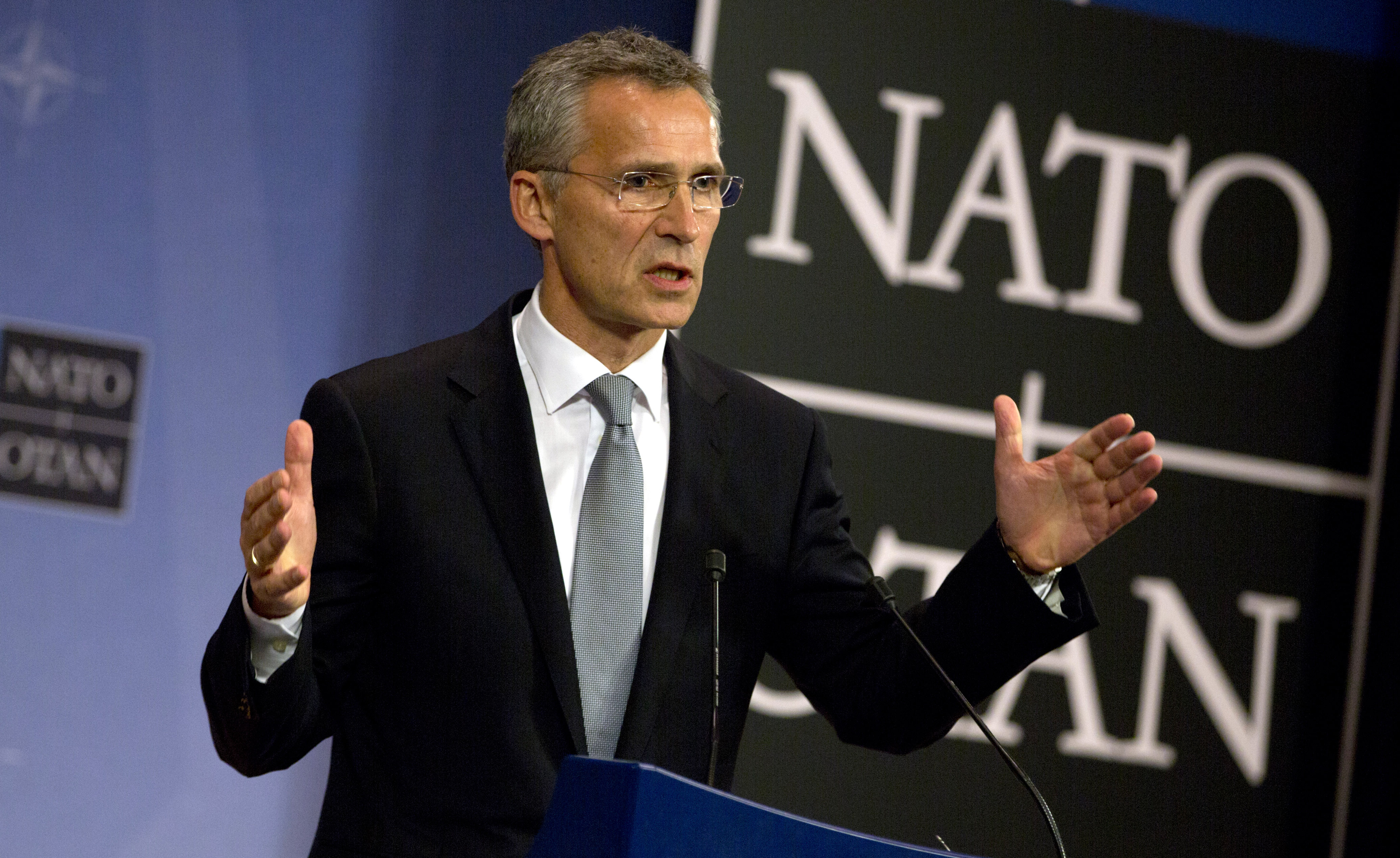 NATO Secretary General Jens Stoltenberg speaks during a news conference at NATO headquarters in Brussels, Oct. 8, 2015.