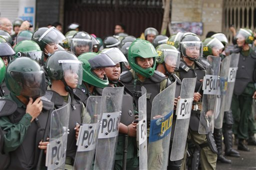 Cambodian riot policemen line up as supporters of opposition parties gather for demonstrations in Phnom Penh, Cambodia