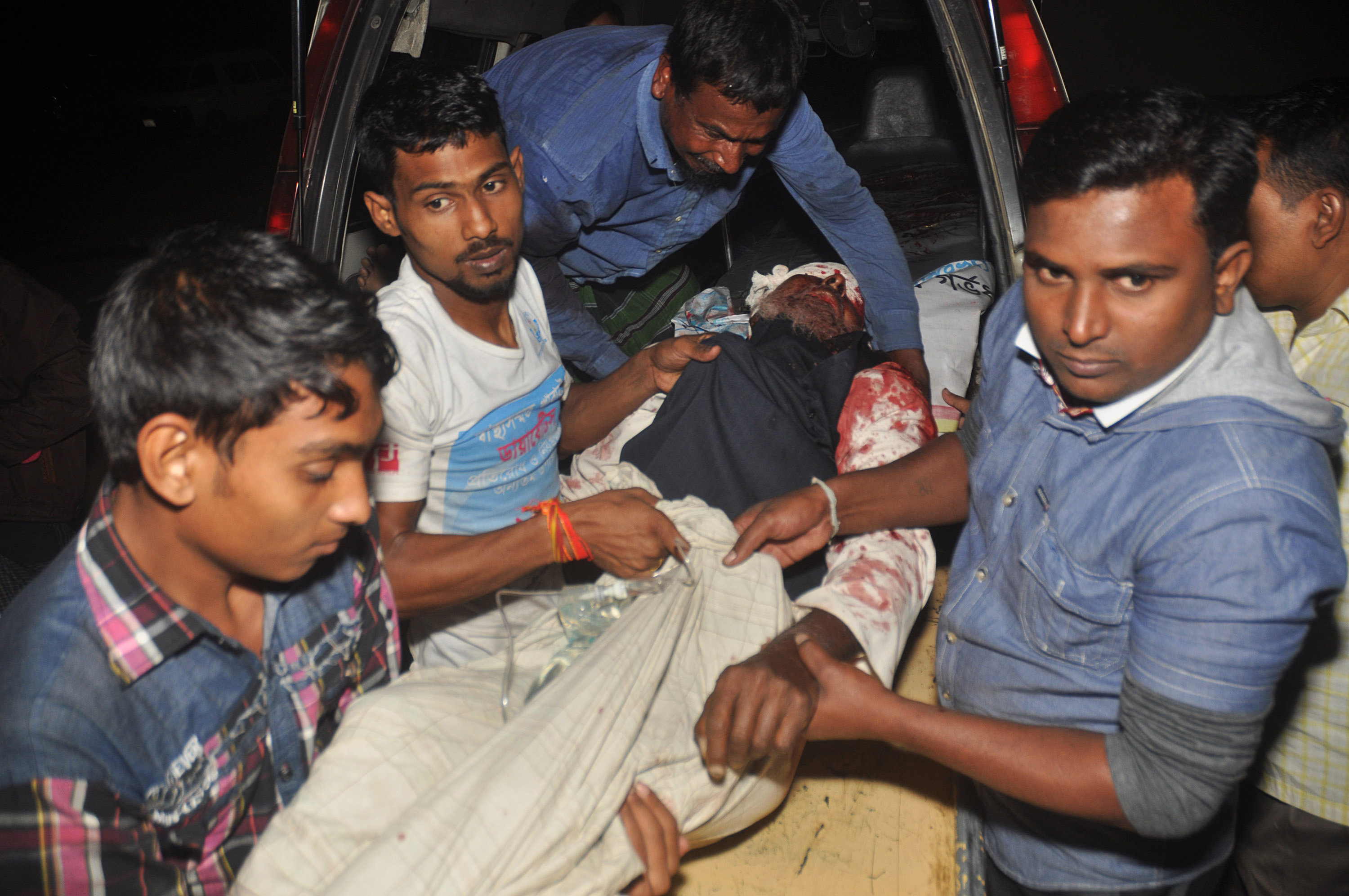 A man injured in an attack on a Shi'ite mosque is carried for treatment in Bogra district, Bangladesh, Nov. 26, 2015.