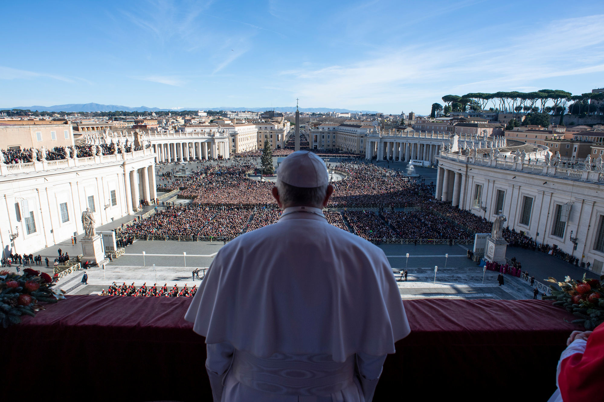 """Pope Francis delivers the """"Urbi et Orbi"""" message from the main balcony of Saint Peter's Basilica at the Vatican, Dec. 25, 2018."""