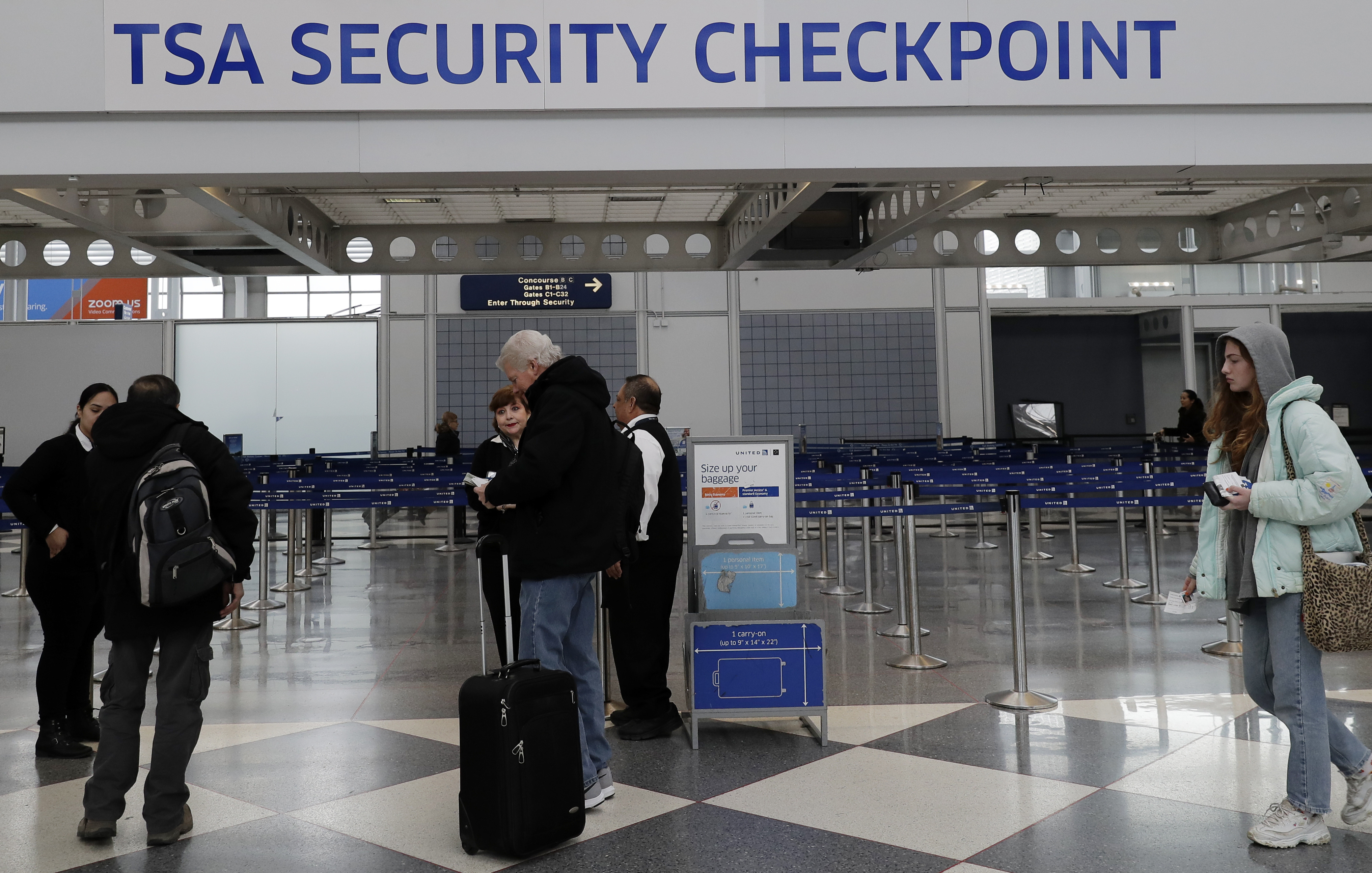 Transportation Security Administration officers work at a checkpoint at O'Hare airport in Chicago, Jan. 11, 2019. This weekend the government shutdown likely stretches on to become the longest in American history.