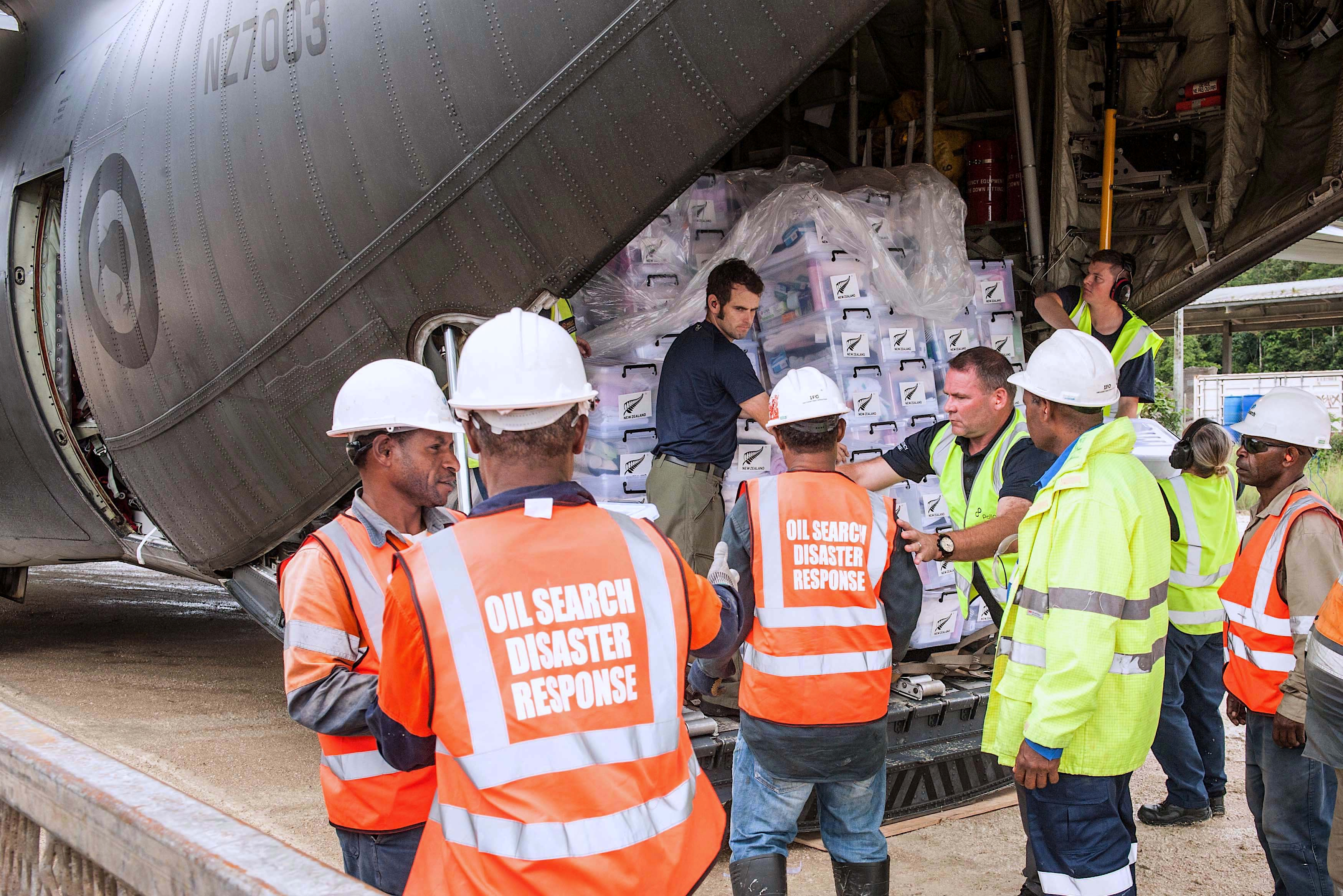 FILE - New Zealand Defense Force personnel unload aid supplies from a C-130 Hercules as part of emergency relief efforts after numerous earthquakes in the highlands region of Papua New Guinea, March 9, 2018.