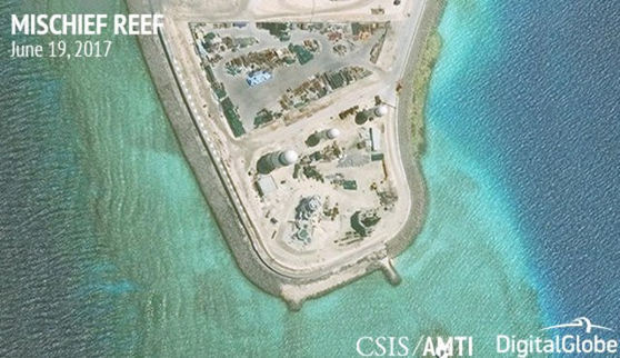 Construction is shown on Mischief Reef in the Spratly Islands, the disputed South China Sea, in this June 19, 2017, satellite image released by CSIS Asia Maritime Transparency Initiative at the Center for Strategic and International Studies (CSIS) to...