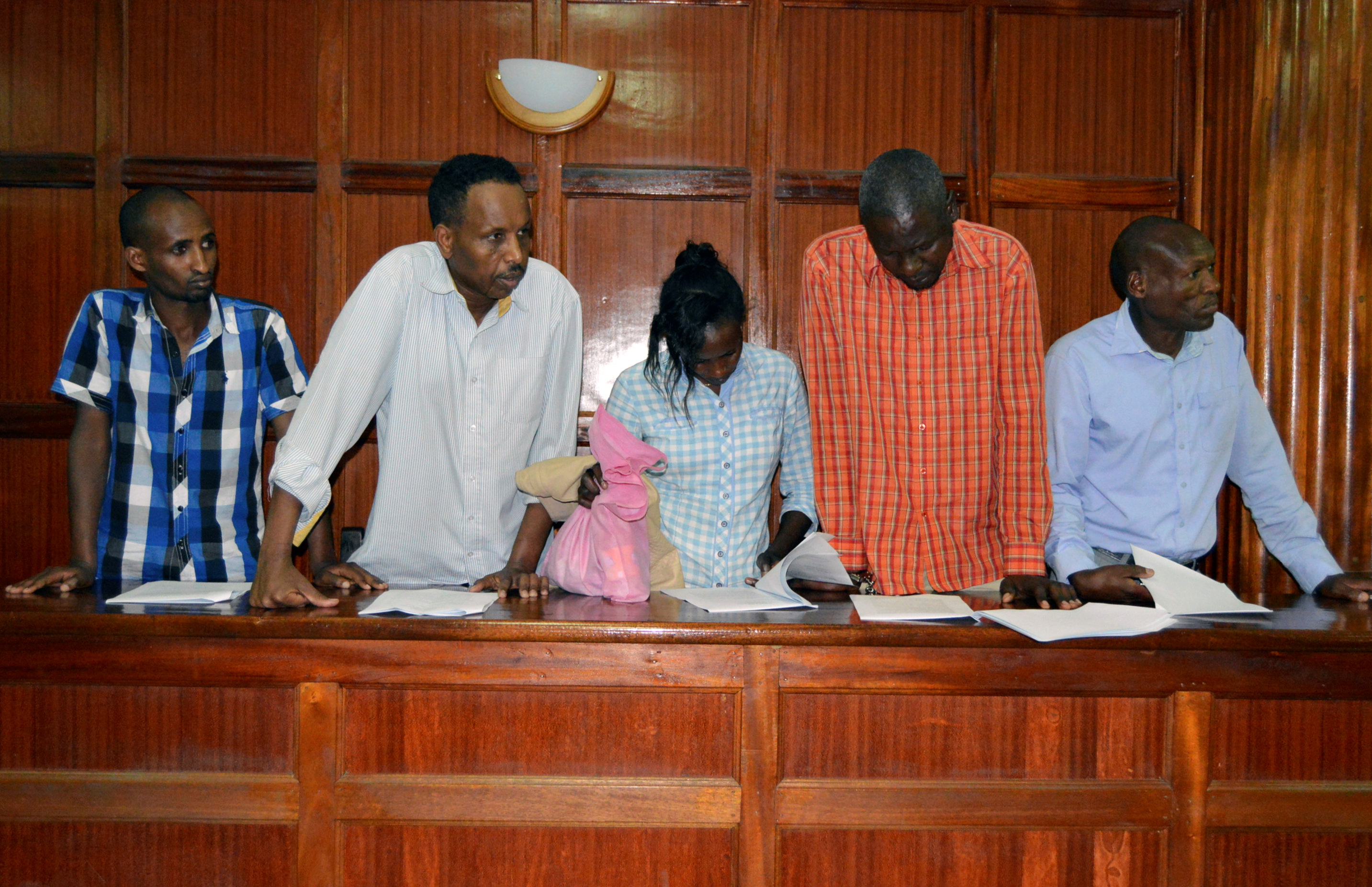 Suspects, left to right, Osman Ibrahim, Oliver Muthee, Gladys Kaari, Guled Abdihakim and Joel Nganga stand in the dock inside the Mililani Law Courts where they appeared in connection with the attack at the DusitD2 complex, in Nairobi, Kenya, Jan. 18...