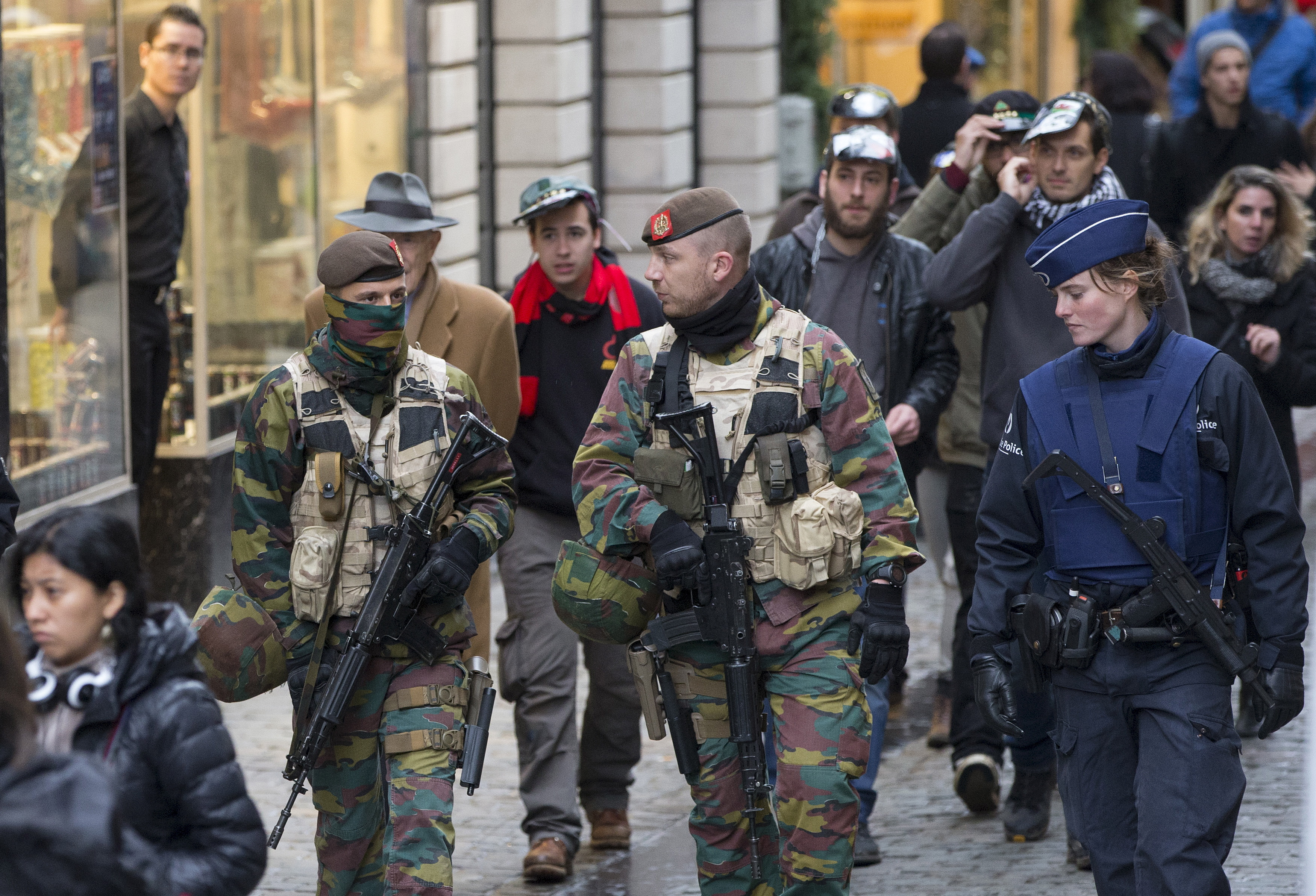 Belgian soldiers and police patrol on Brussels Grand Place after security was tightened in Belgium following the fatal attacks in Paris last week, in Brussels, Belgium, Nov. 20, 2015.