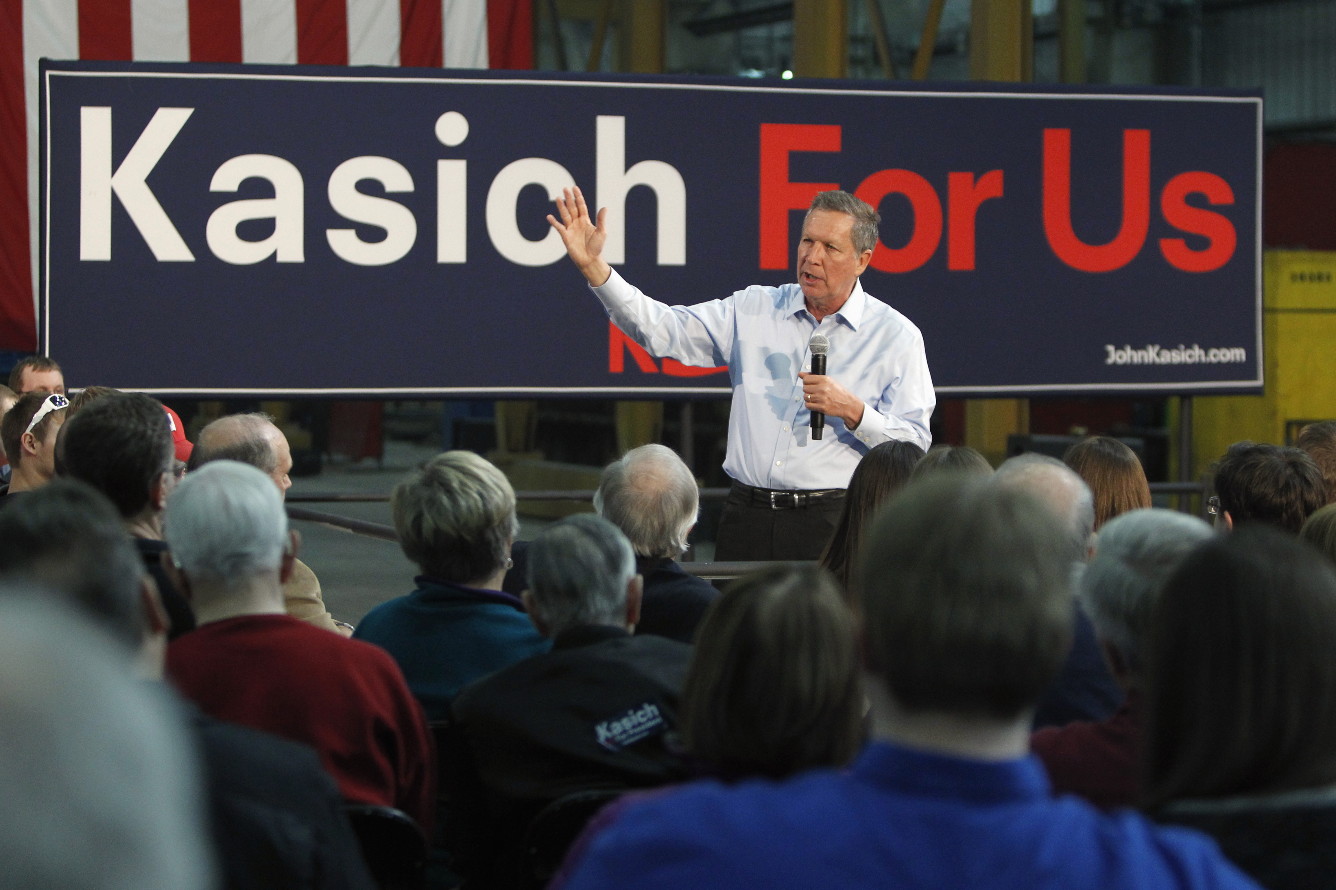 Republican presidential candidate, Ohio Gov. John Kasich speaks at a town hall meeting at Weldall Manufacturing in Waukesha, Wisconsin, March 29, 2016.