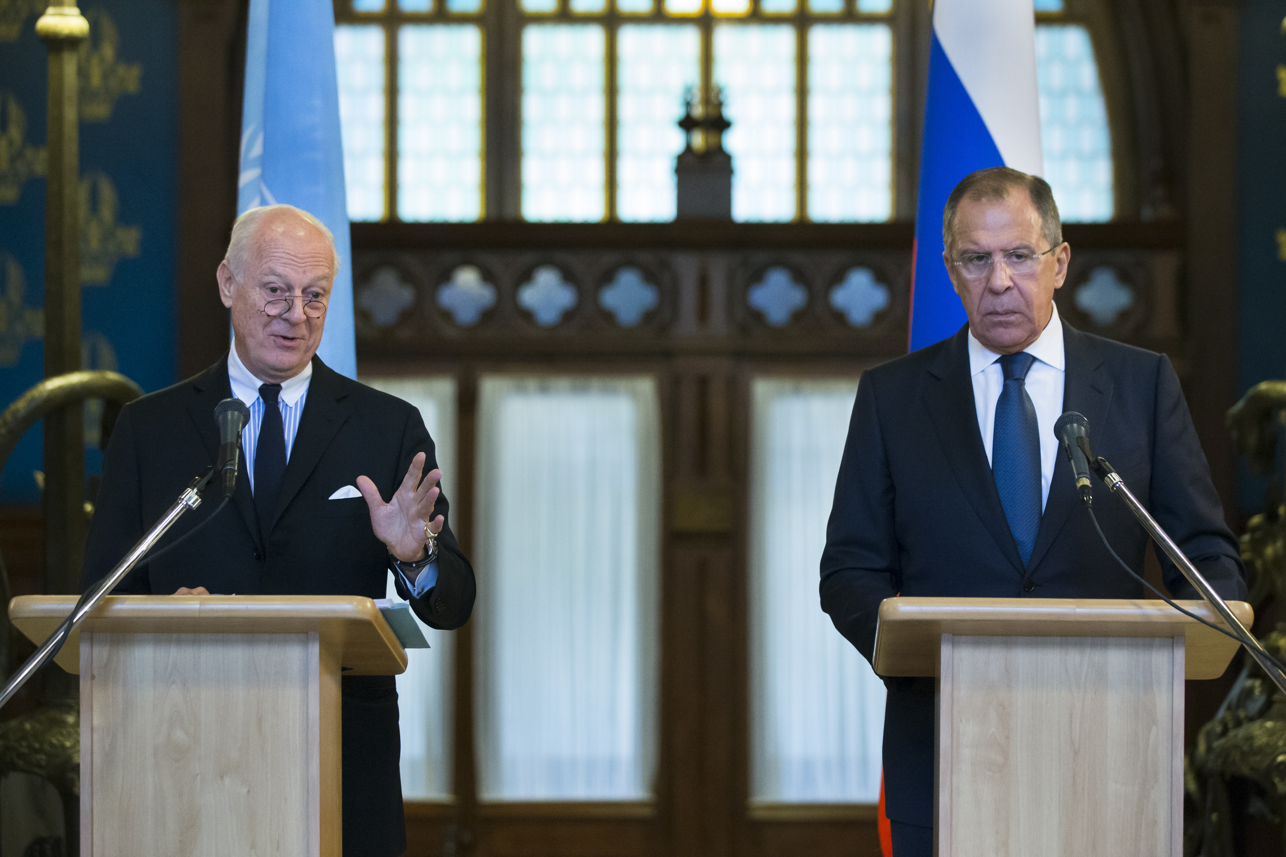 Russian Foreign Minister Sergey Lavrov, right, listens as U.N. Special Envoy for Syria Staffan de Mistura speaks during a news conference following their talks in Moscow, Russia, Nov. 4, 2015.