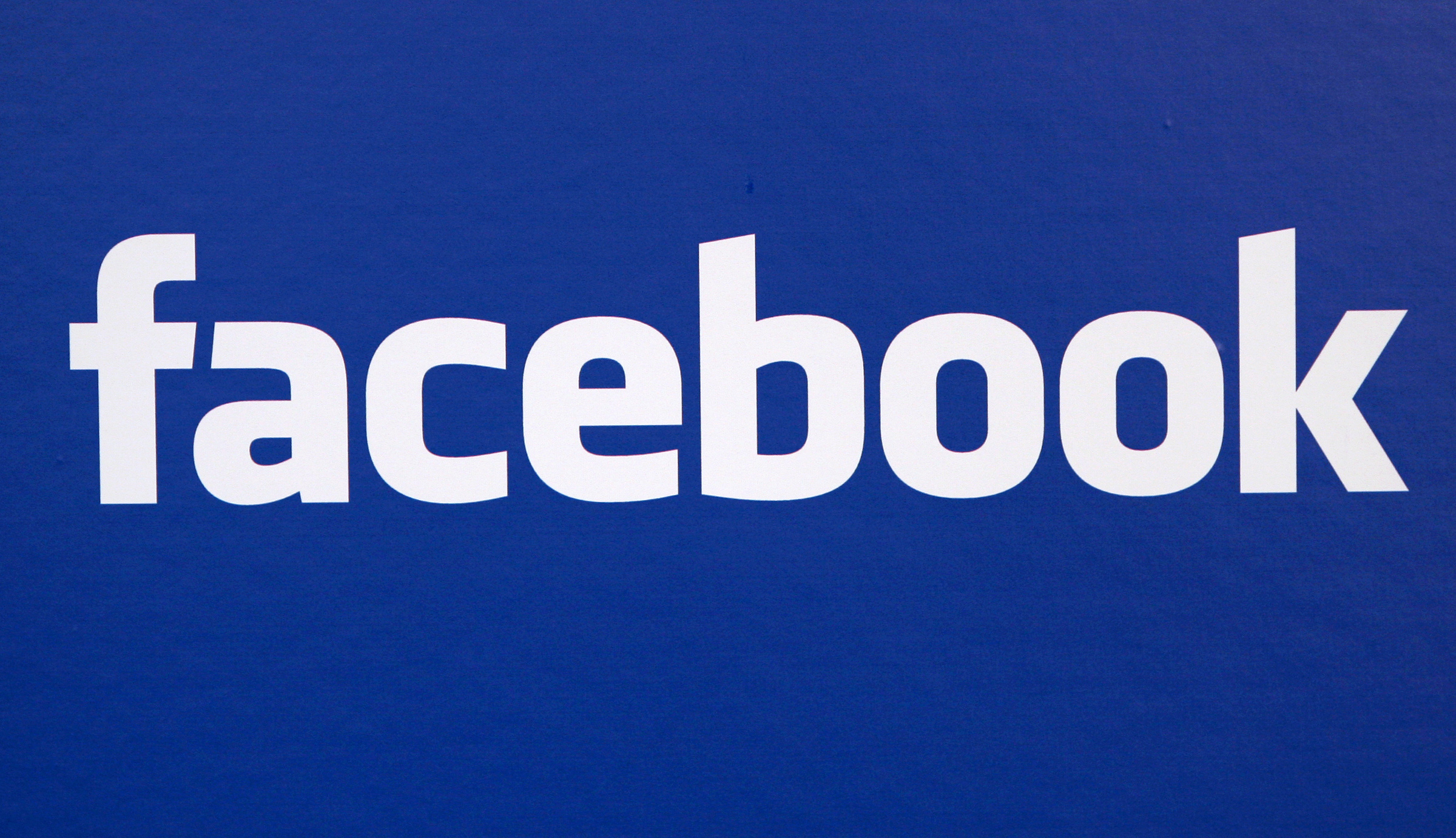 FILE - In this Nov. 6, 2007 file photo, the Facebook logo is displayed at a Facebook announcement in New York.