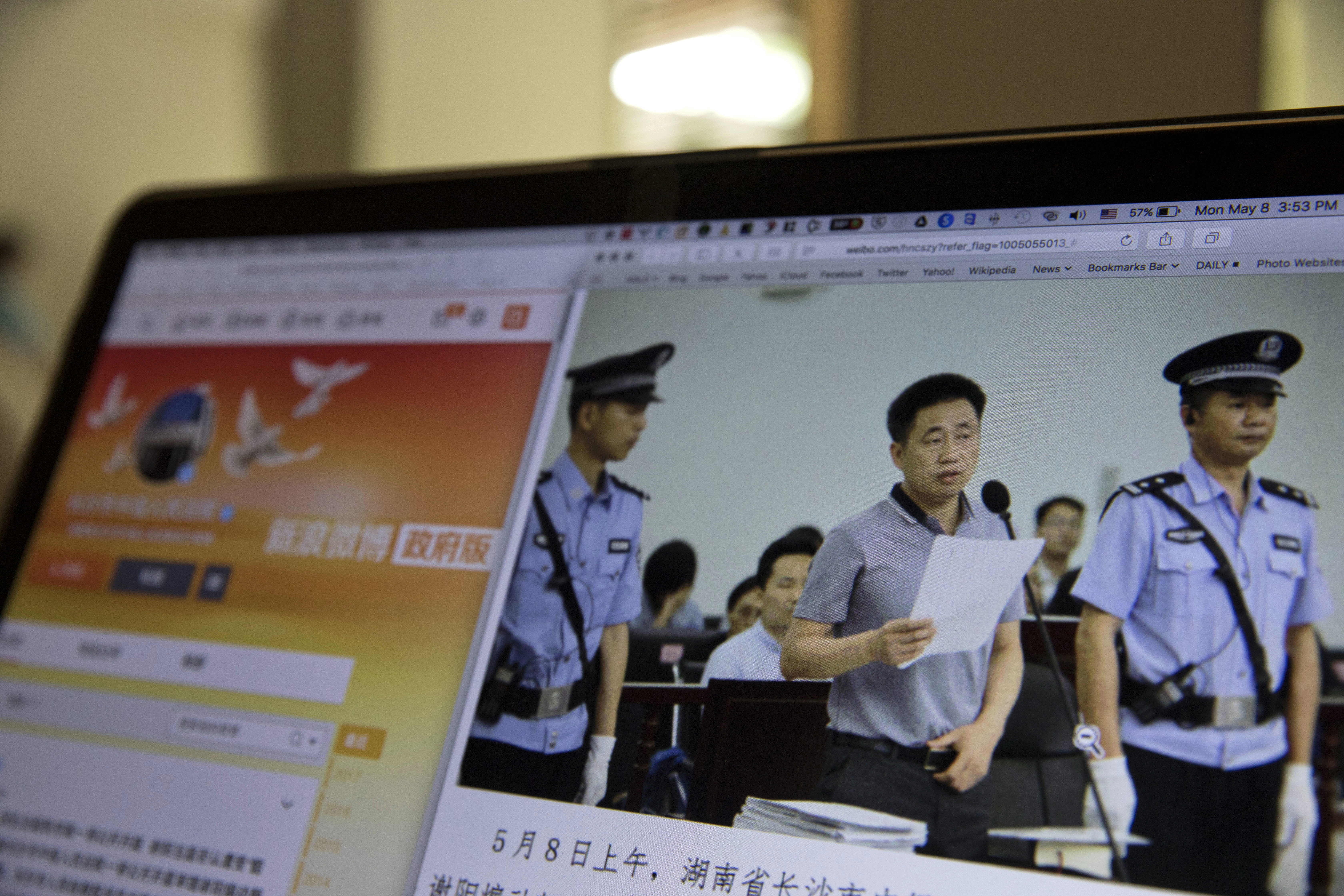 A photo described as the trial showing human rights lawyer Xie Yang which is seen on the social media of the Changshai Intermediate People's Court is displayed on a computer in Beijing, May 8, 2017.