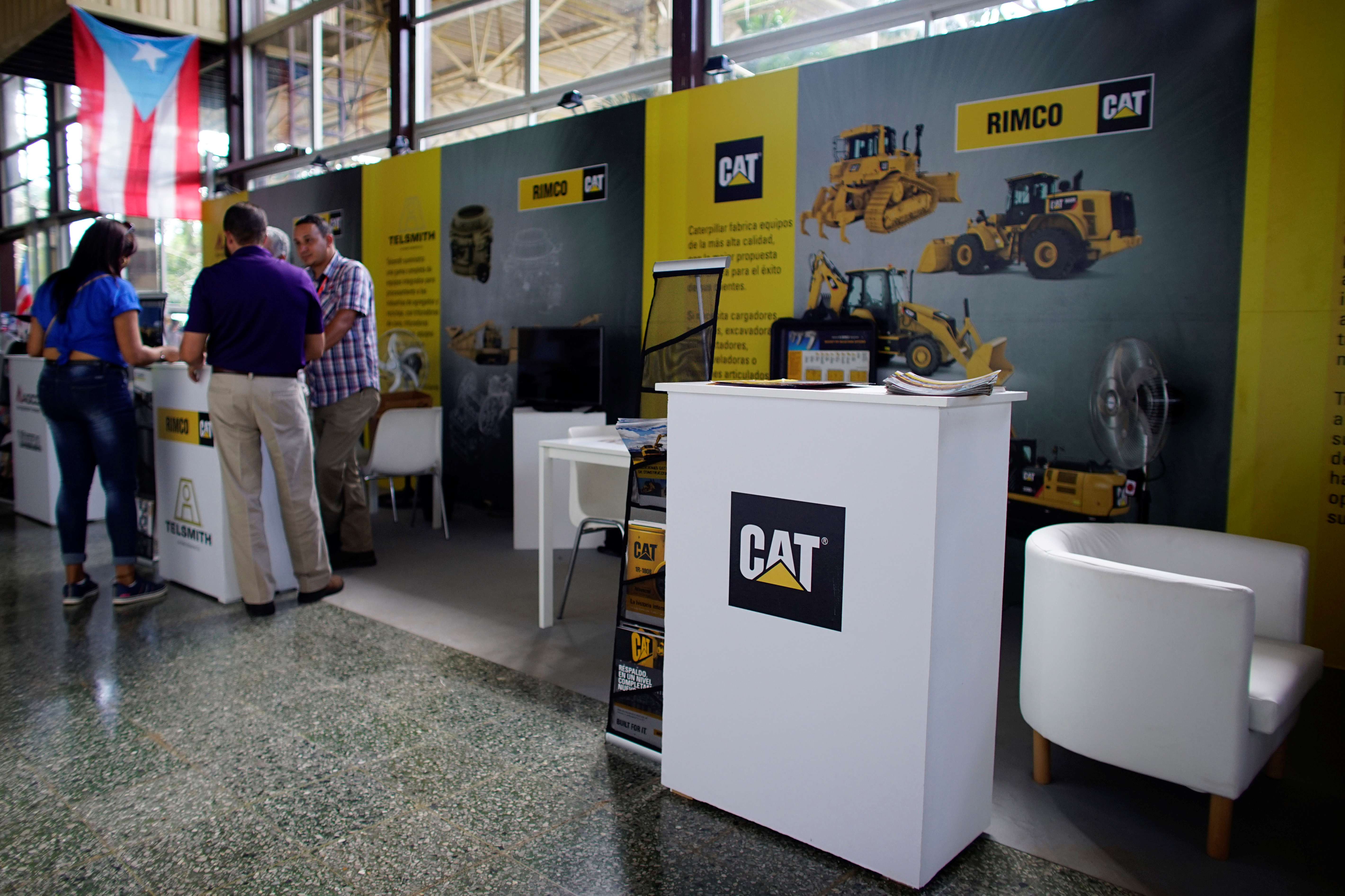 FILE - A view of the booth of Rimco, Caterpillar Inc's dealer for Cuba, at the 35th Havana International Fair in Havana, Cuba, Nov. 1, 2017.