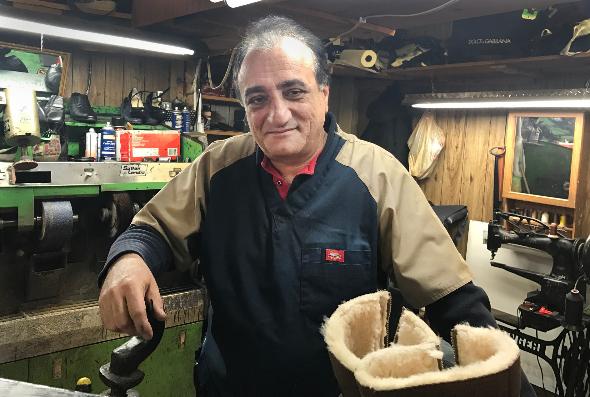 "Roman Gadayev works in his Brighton Beach shoe repair shop in New York, Dec. 15, 2016. Gadayev holds a firm view on allegations that Russia meddled in the U.S. presidential election. ""Simply impossible,"" said the Kazakhstan native."