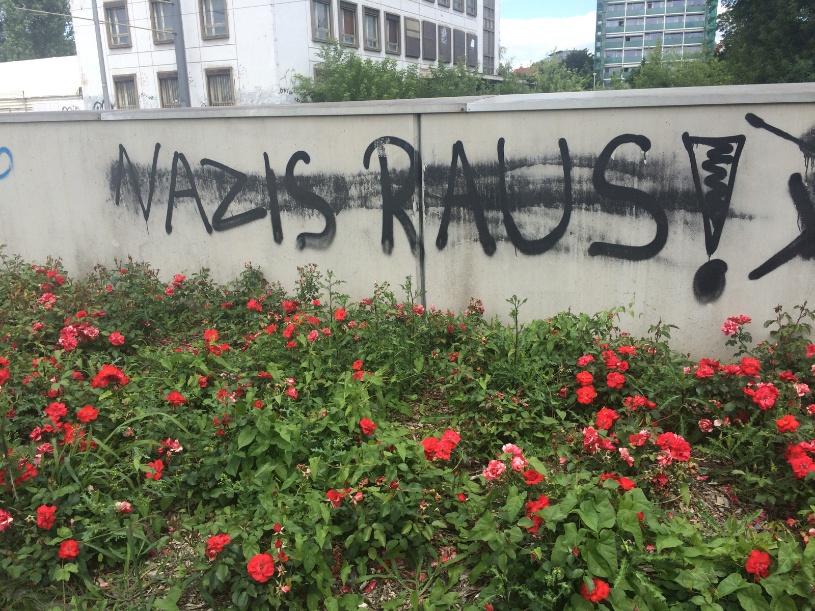 """Anti-immigrant protests in Dresden, Germany have also inspired counter-protests and graffiti like this that says 'Nazis Out!"""", July 7, 2016. (H. Murdock/VOA)"""