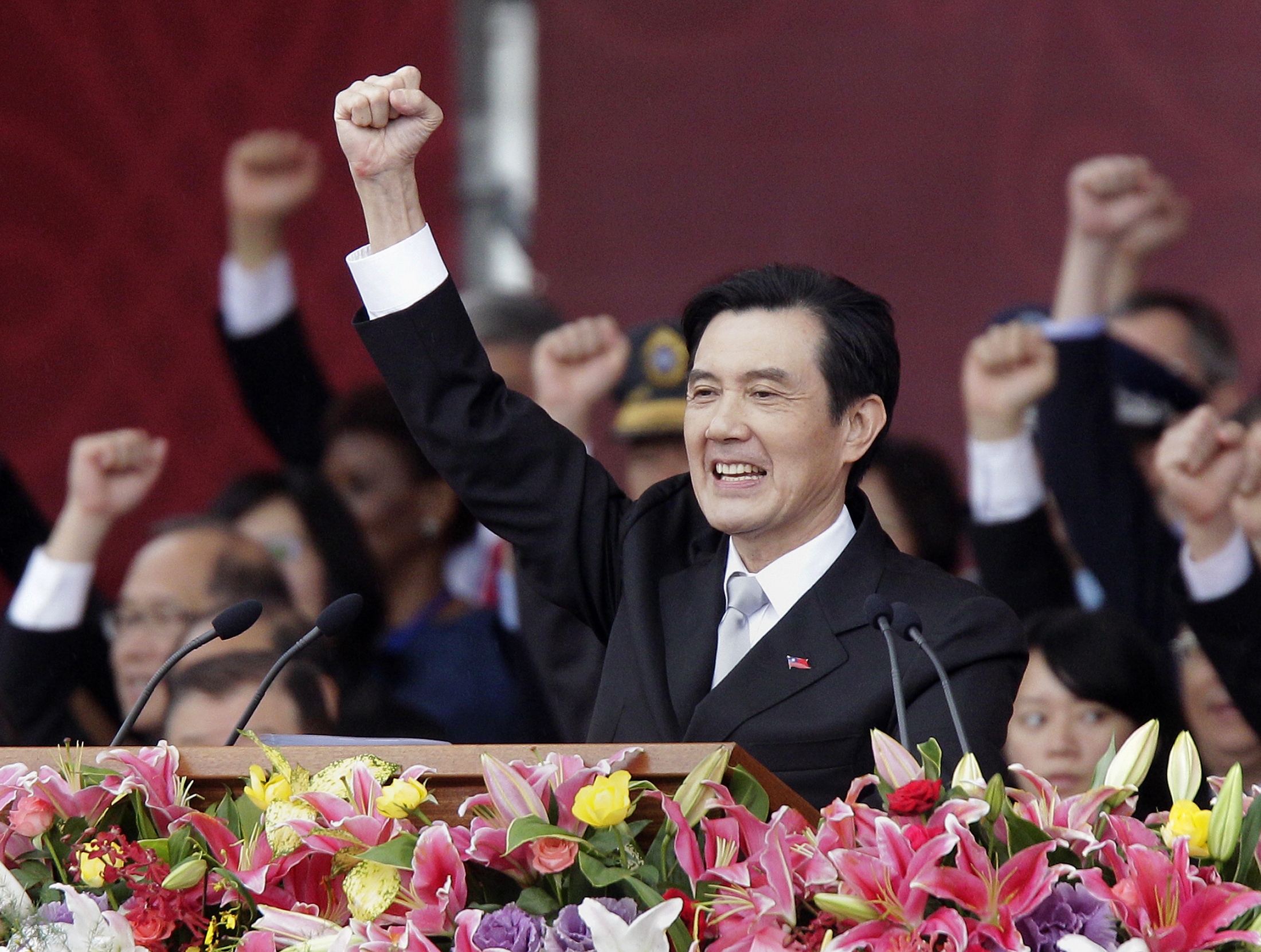 Taiwan's President Ma Ying-jeou raises his fist after giving a speech during National Day celebrations in front of the presidential office in Taipei October 10, 2012.