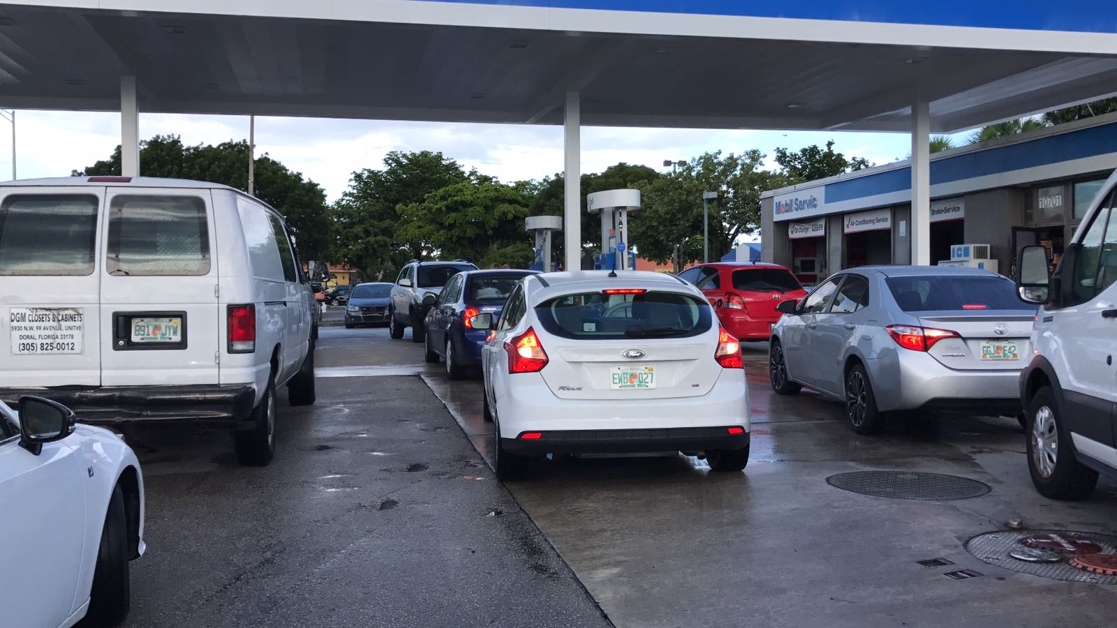 Drivers flock to gas stations to fill their cars with fuel before Hurricane Irma strikes, in Miami, Florida, Sept. 7, 2017.