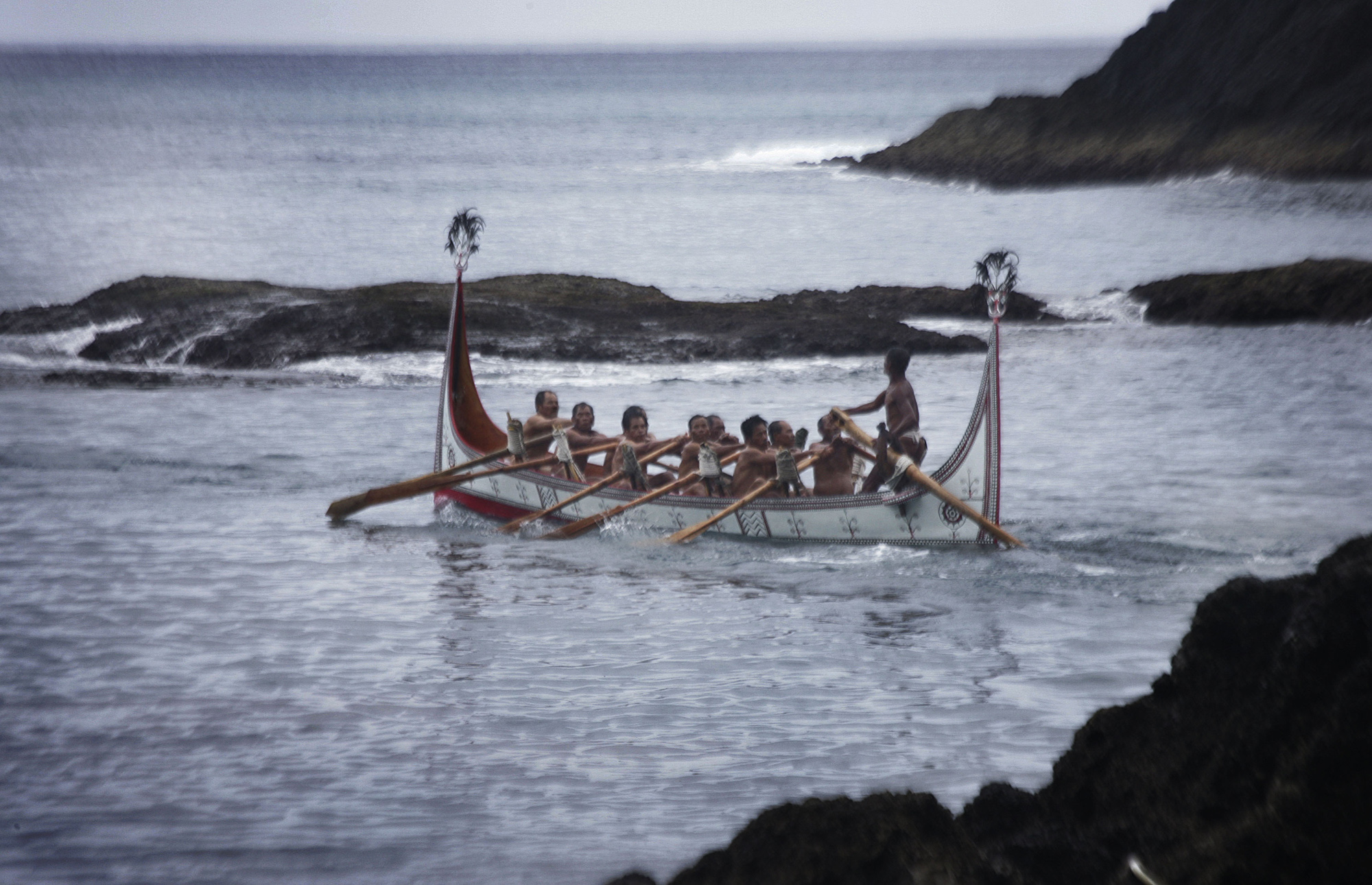 FILE - Aboriginal men of the Tao tribe take a newly launched fishing boat on a maiden voyage during a fishing boat launching ceremony on Orchid Island, Taiwan.