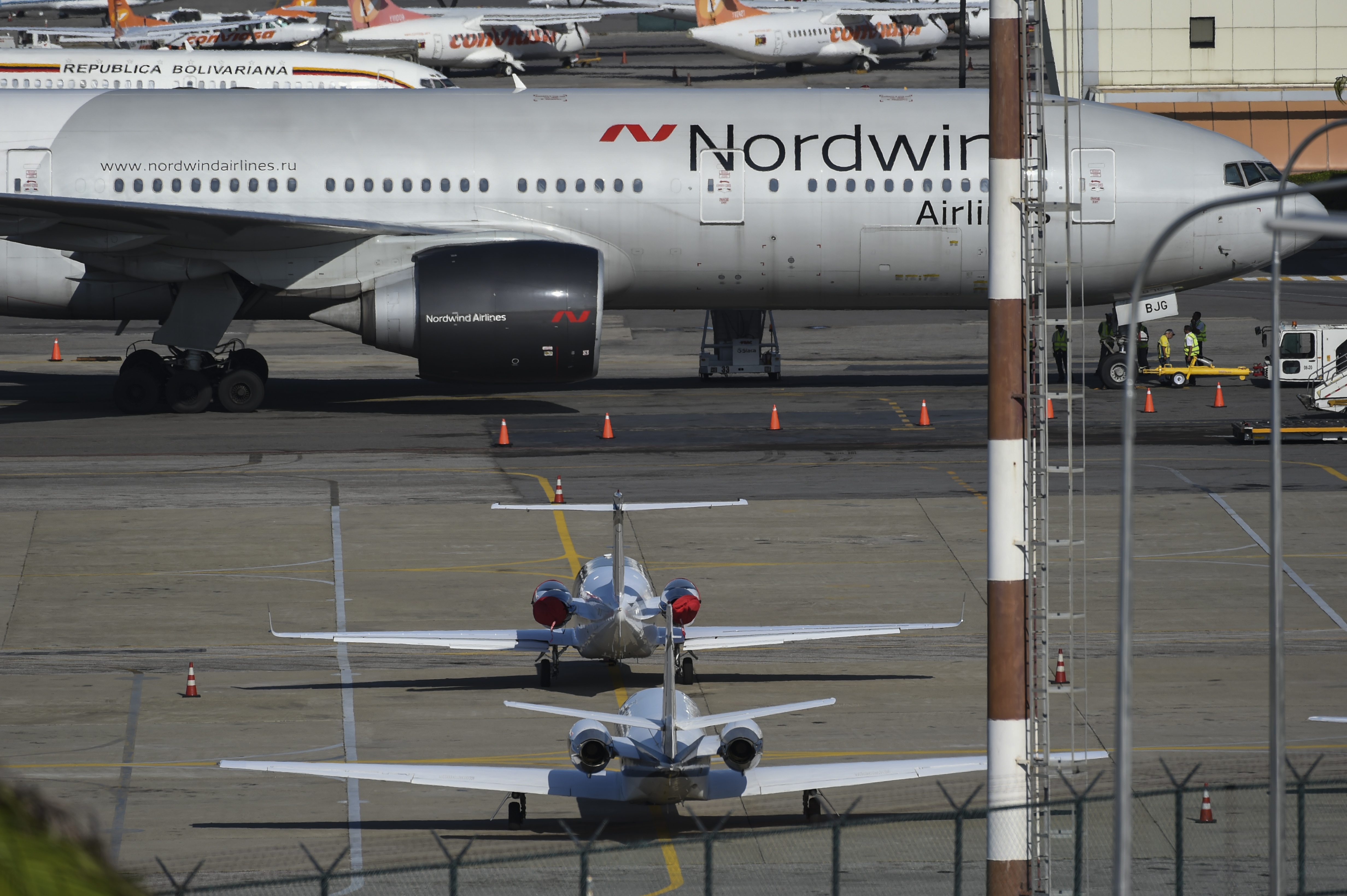 A Boeing 777 from Russia's Nordwind Airlines remains parked on the runway at La Guaira airport, near Caracas on Jan. 30, 2019.