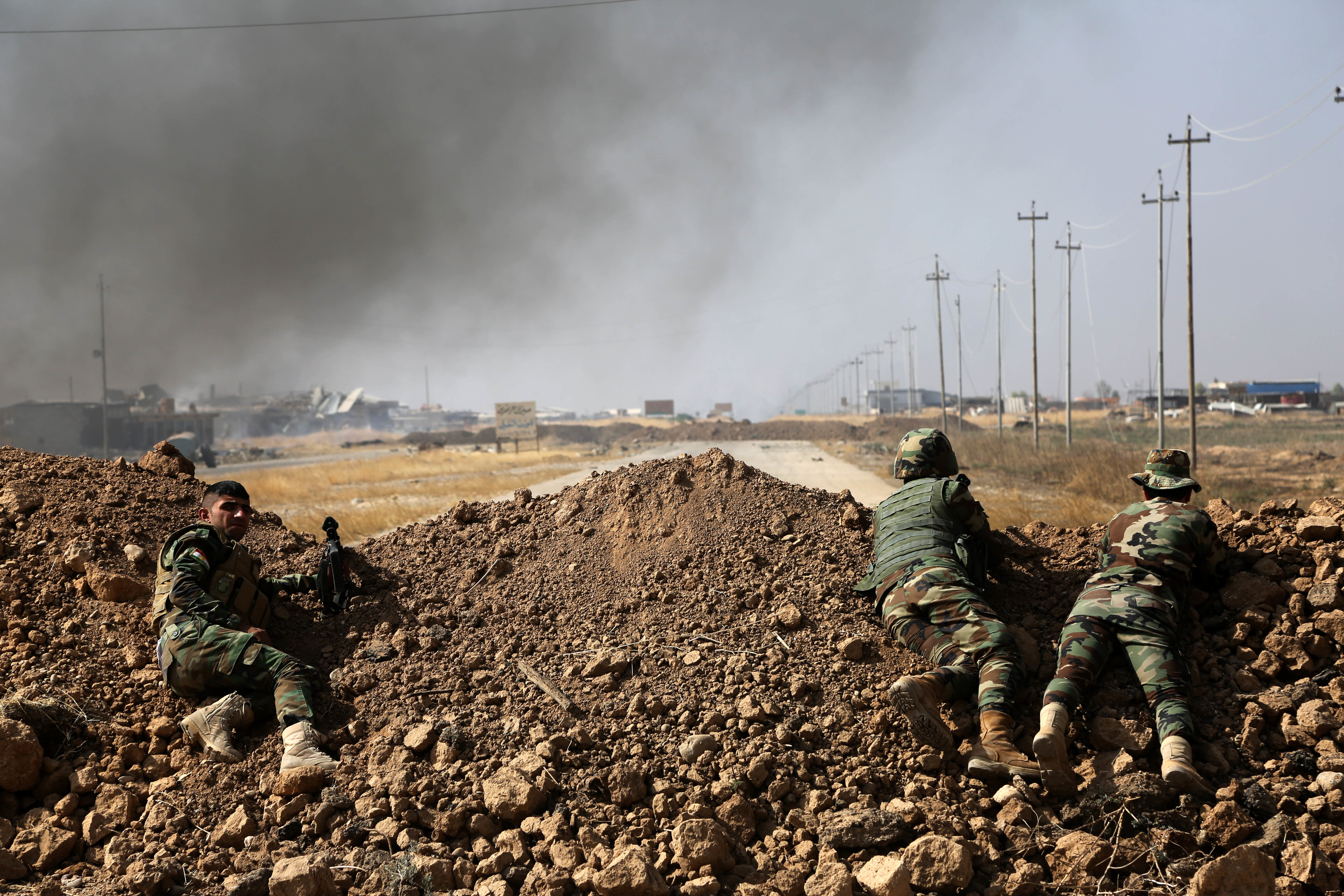 Kurdish security forces take up a position as they fight overlooking the Islamic State-controlled in villages surrounding Mosul, in Khazer, about 30 kilometers (19 miles) east of Mosul, Iraq, Oct. 17, 2016.