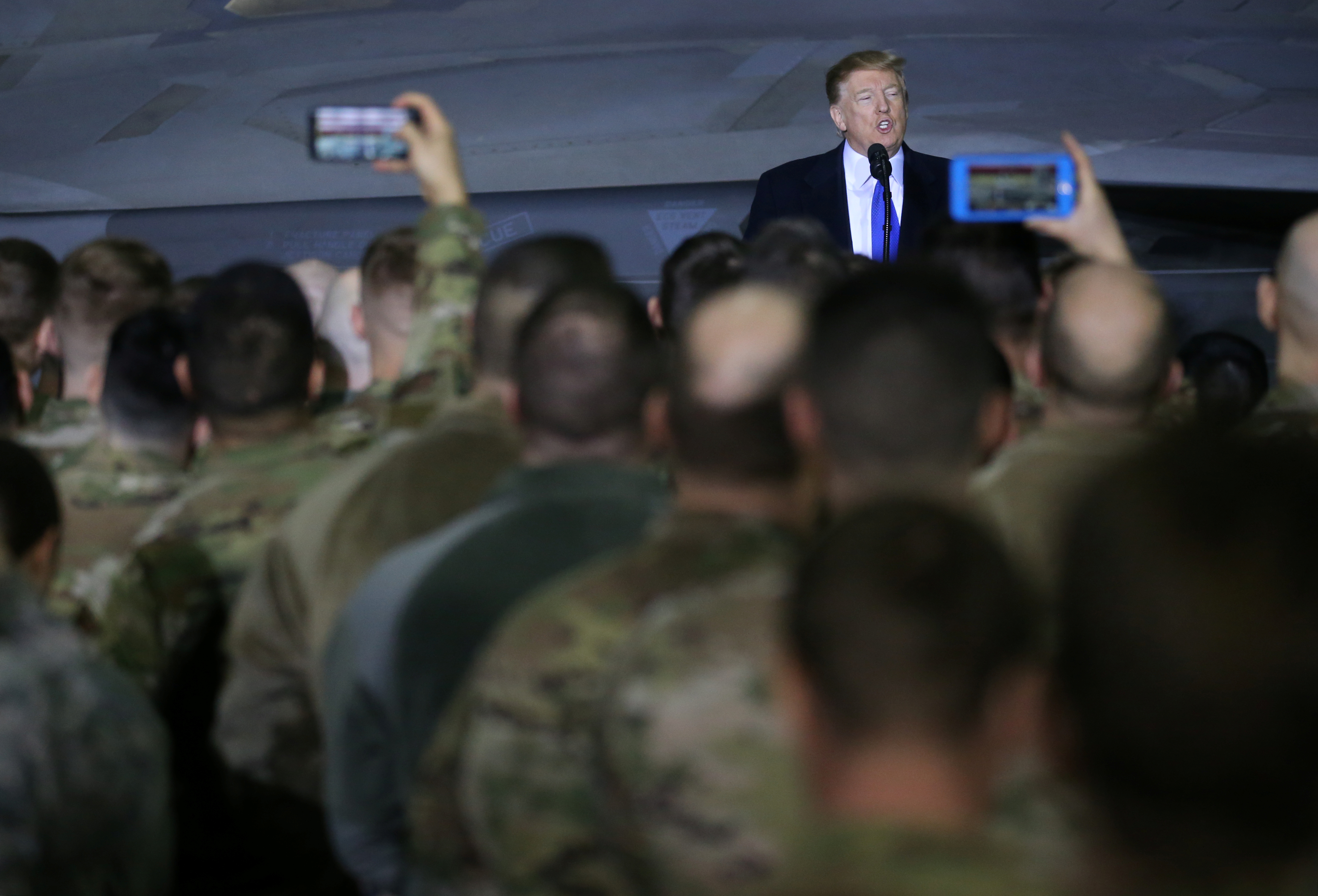 President Donald Trump speaks to members of the U.S. military after his summit meeting with North Korea's Kim Jong Un in Vietnam, during a refueling stop at Elmendorf Air Force Base in Anchorage, Alaska, Feb. 28, 2019.