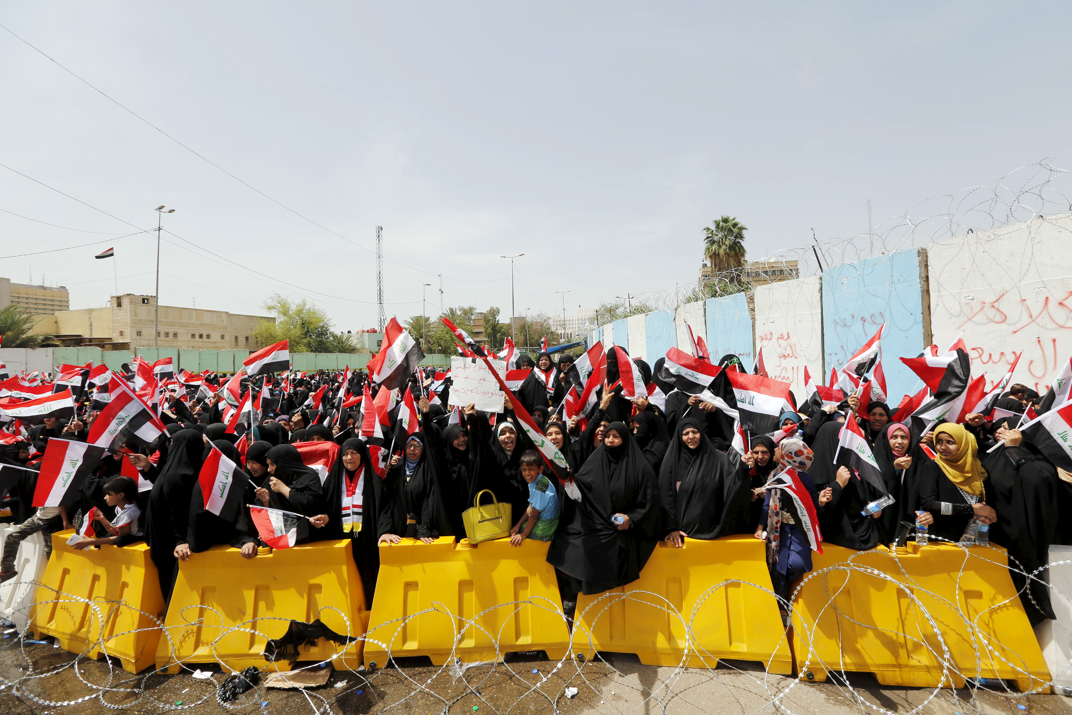 Followers of Iraq's Shi'ite cleric Moqtada al-Sadr wave Iraqi flags during a protest demanding that parliament approve a long-delayed new cabinet, in Baghdad, Iraq, April 26, 2016.
