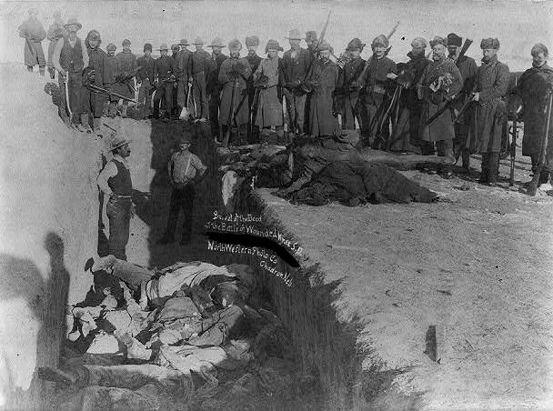 U.S. Soldiers burying frozen bodies of Native Americans at Wounded Knee, South Dakota,  Jan. 17, 1891, two weeks after the the massacre.