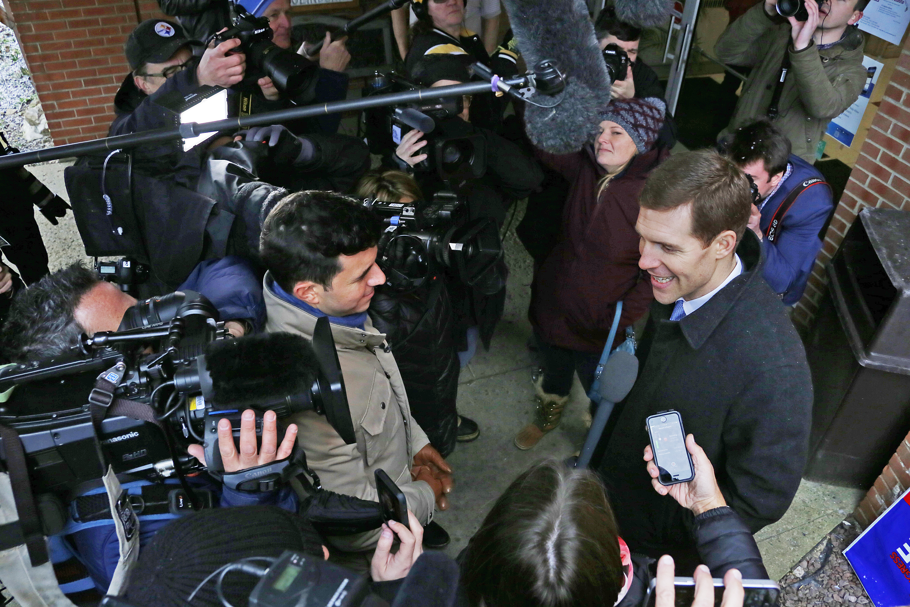 Conor Lamb, the Democratic candidate for the March 13 special election in Pennsylvania's 18th Congressional District, talks with reporters in Carnegie, Pennsylvania, March 13, 2018.