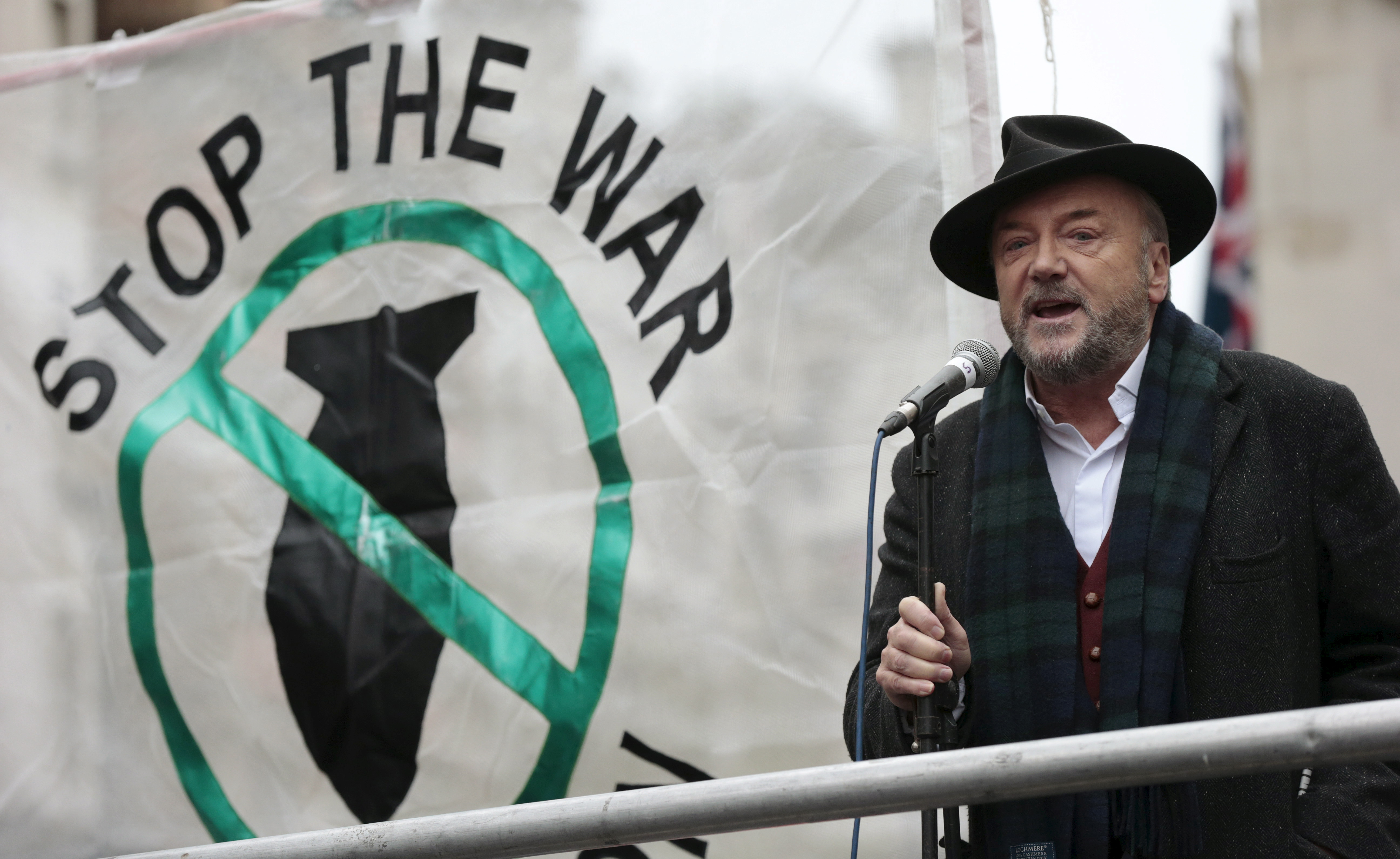 Anti-war activist and former British member of parliament George Galloway speaks at a rally against taking military action against Islamic State in Syria, outside Downing Street in London, Nov. 28, 2015.