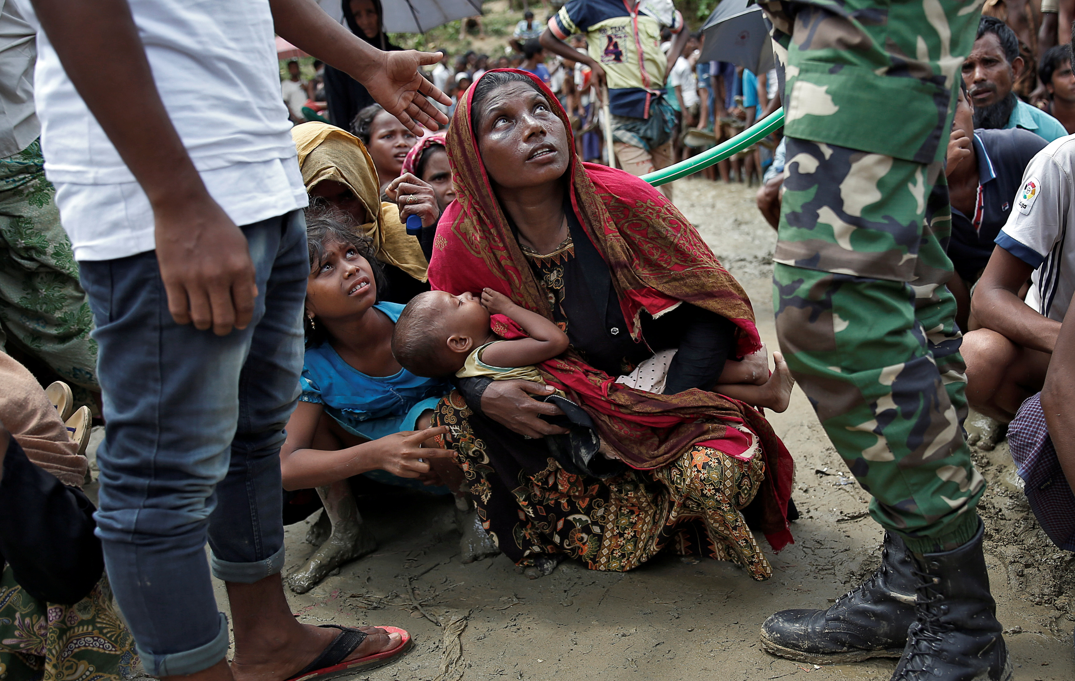 Rohingya refugees wait to receive aid in Cox's Bazar, Bangladesh, Sept. 27, 2017.