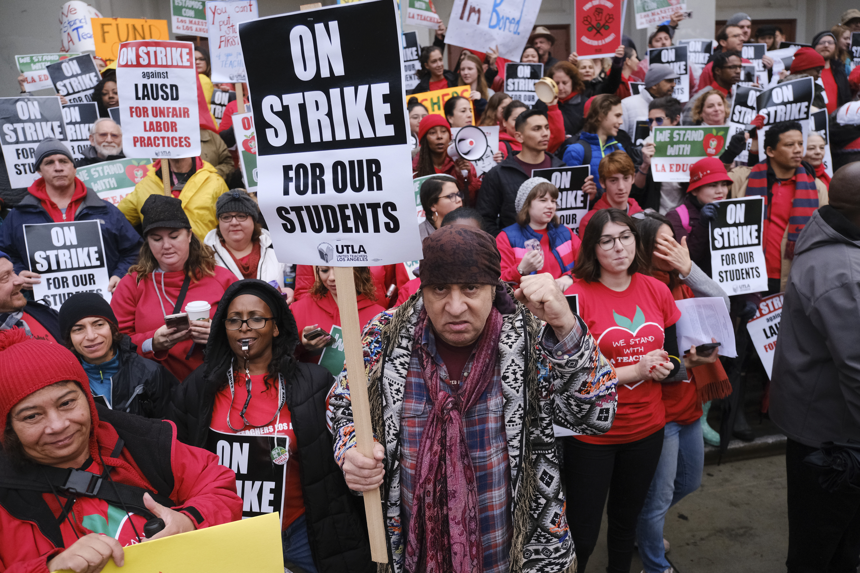 Actor, musician and activist, Steven Van Zandt, center, supports striking teachers on the picket in front of Hamilton High School in Los Angeles, Jan. 16, 2019.