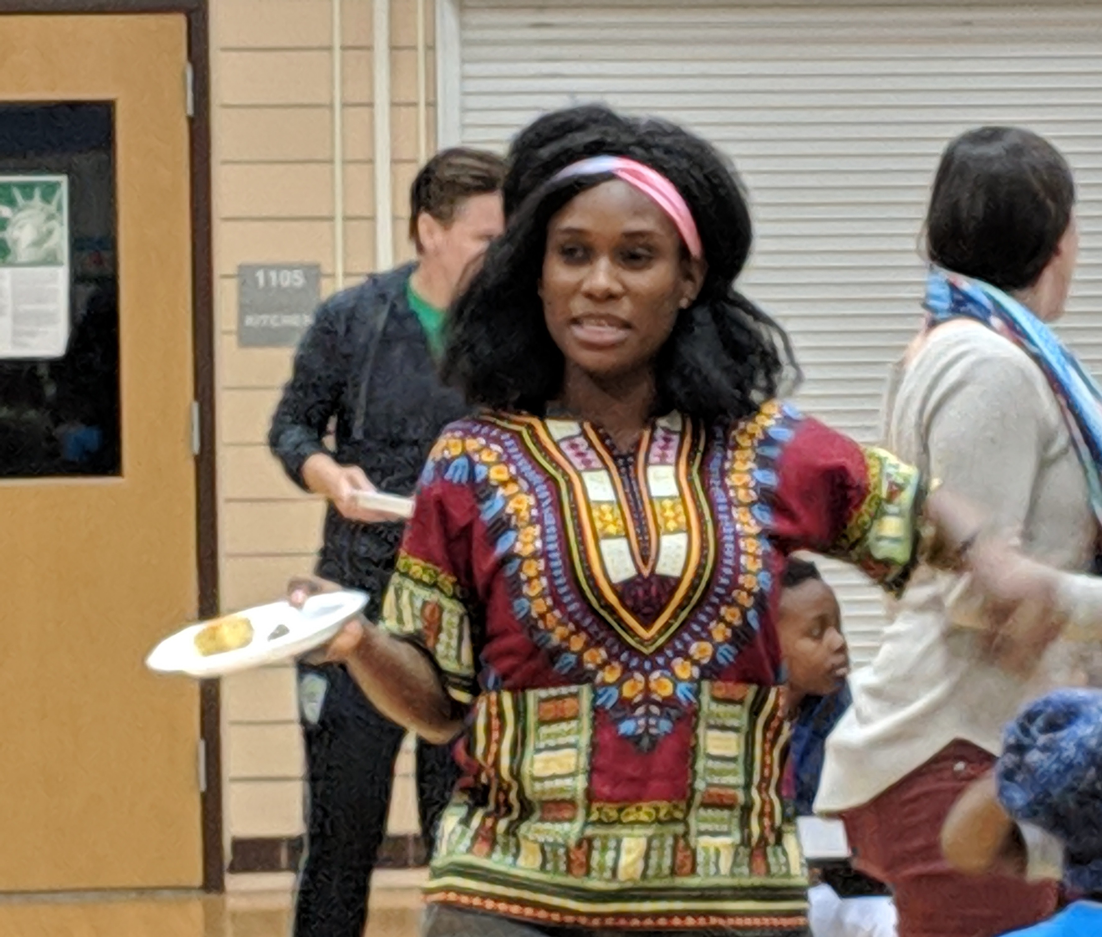 Tricia Gabriel, co-founder of Genesis Youth Foundation, hands out snacks to children in the program, in Des Moines, Iowa, Jan. 28, 2019.