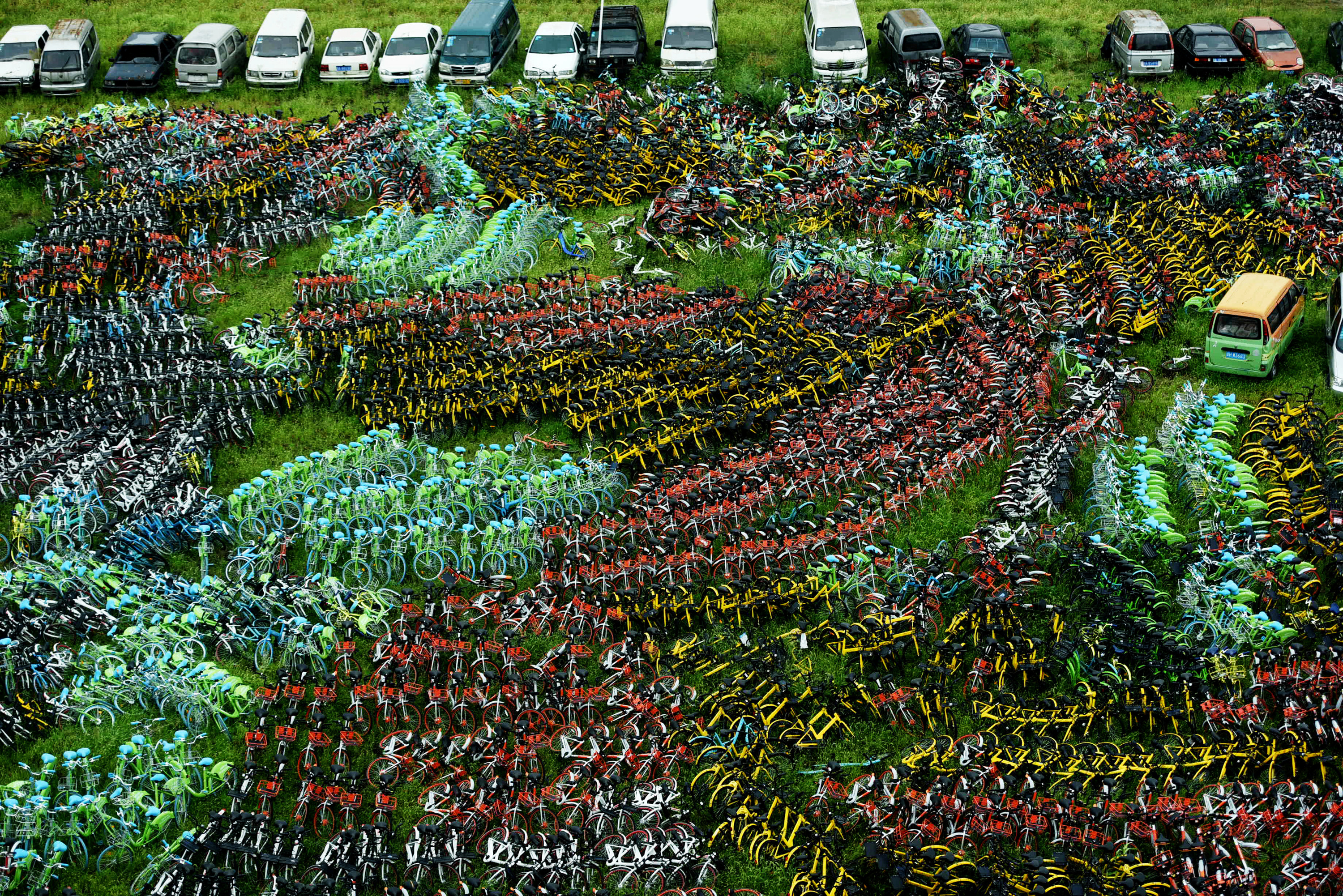 Bicycles of various bike-sharing services are seen at an urban village in Hangzhou, Zhejiang province, China September 7, 2017.