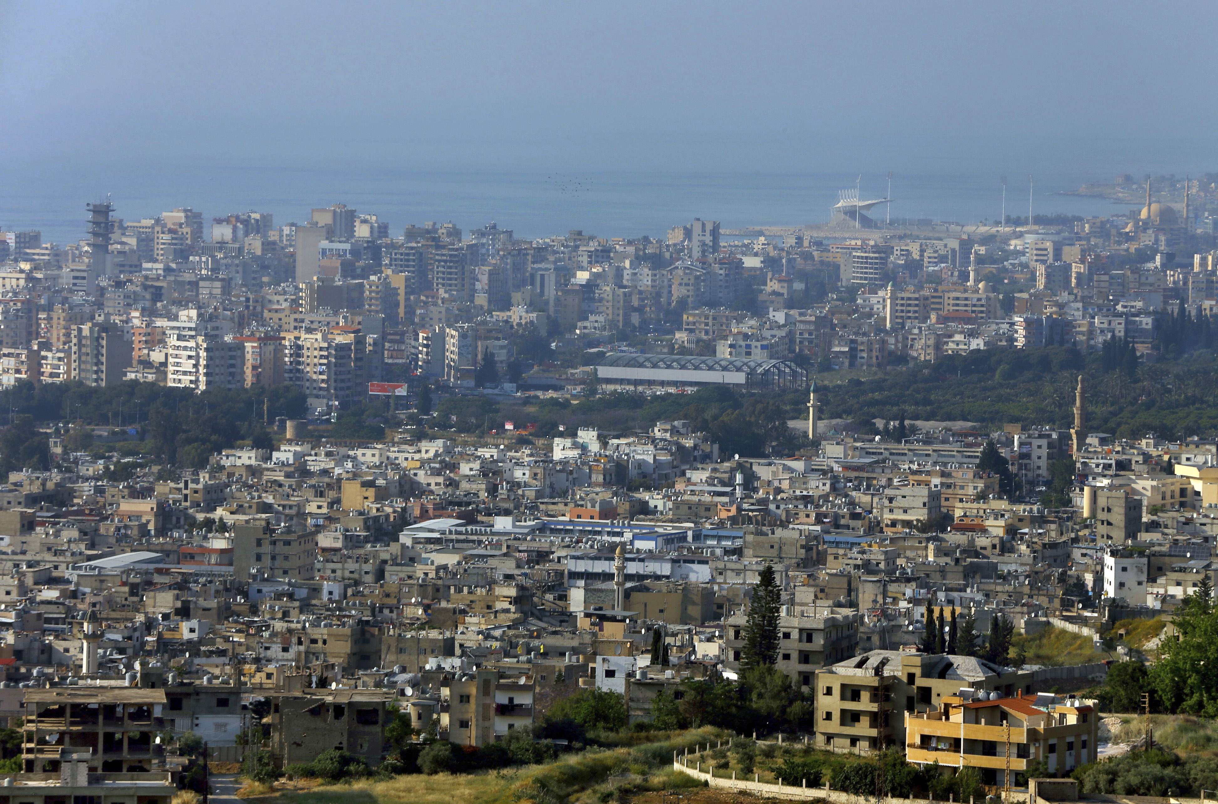 A general view, foreground, of the Ein el-Hilweh Palestinian refugee camp near the southern port city of Sidon, Lebanon, May 5, 2017.