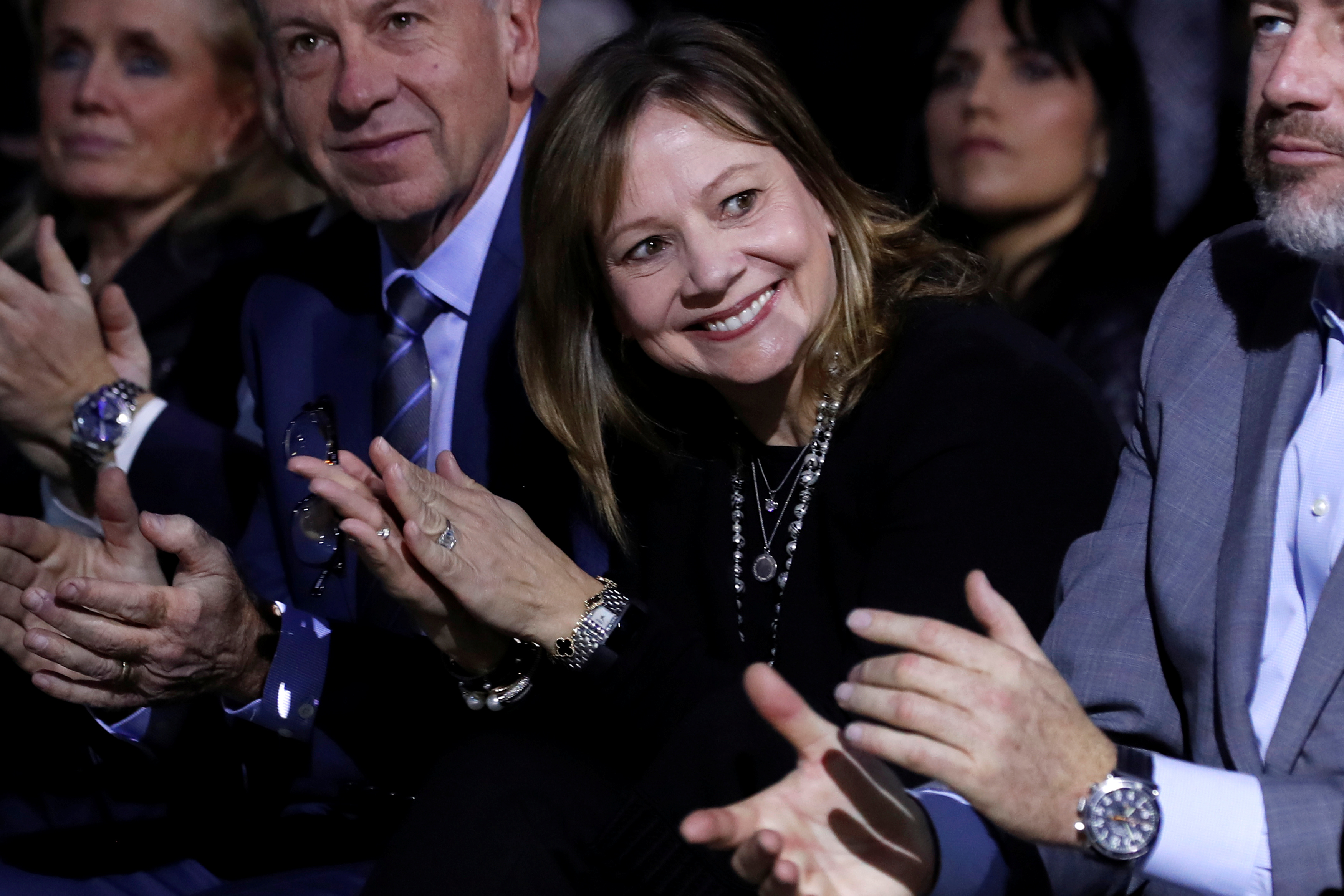 General Motors CEO Mary Barra applauds some of her company managers as they are introduced at a Chevrolet truck unveiling at the North American International Auto Show in Detroit, Michigan, Jan. 13, 2018.
