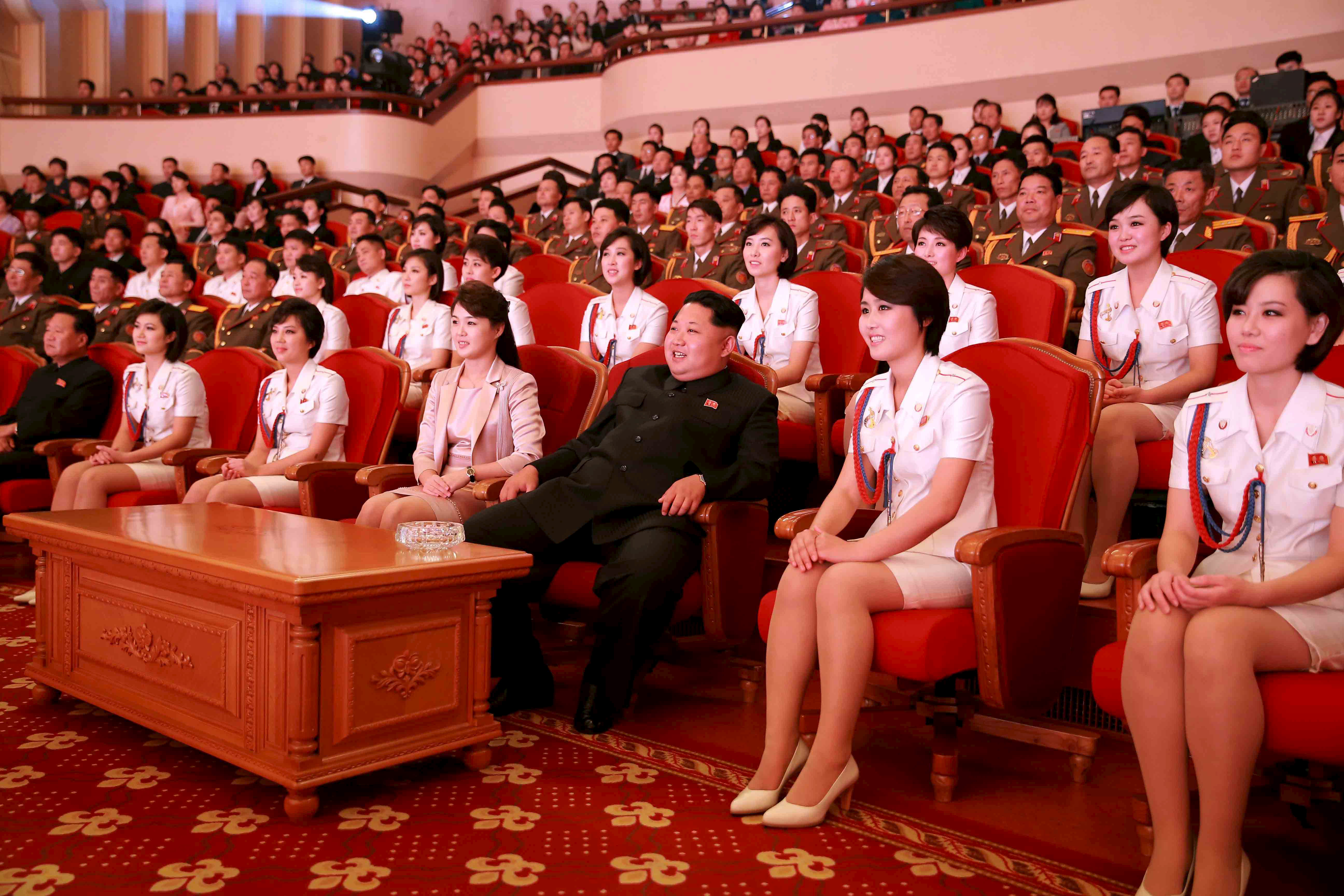 North Korean leader Kim Jong Un (3rd R) and wife Ri Sol Ju (4th L) enjoy an art performance given by the Chongbong Band to mark the 70th anniversary of the founding of the Workers' Party of Korea (WPK) in this undated photo released by North Korea's ...