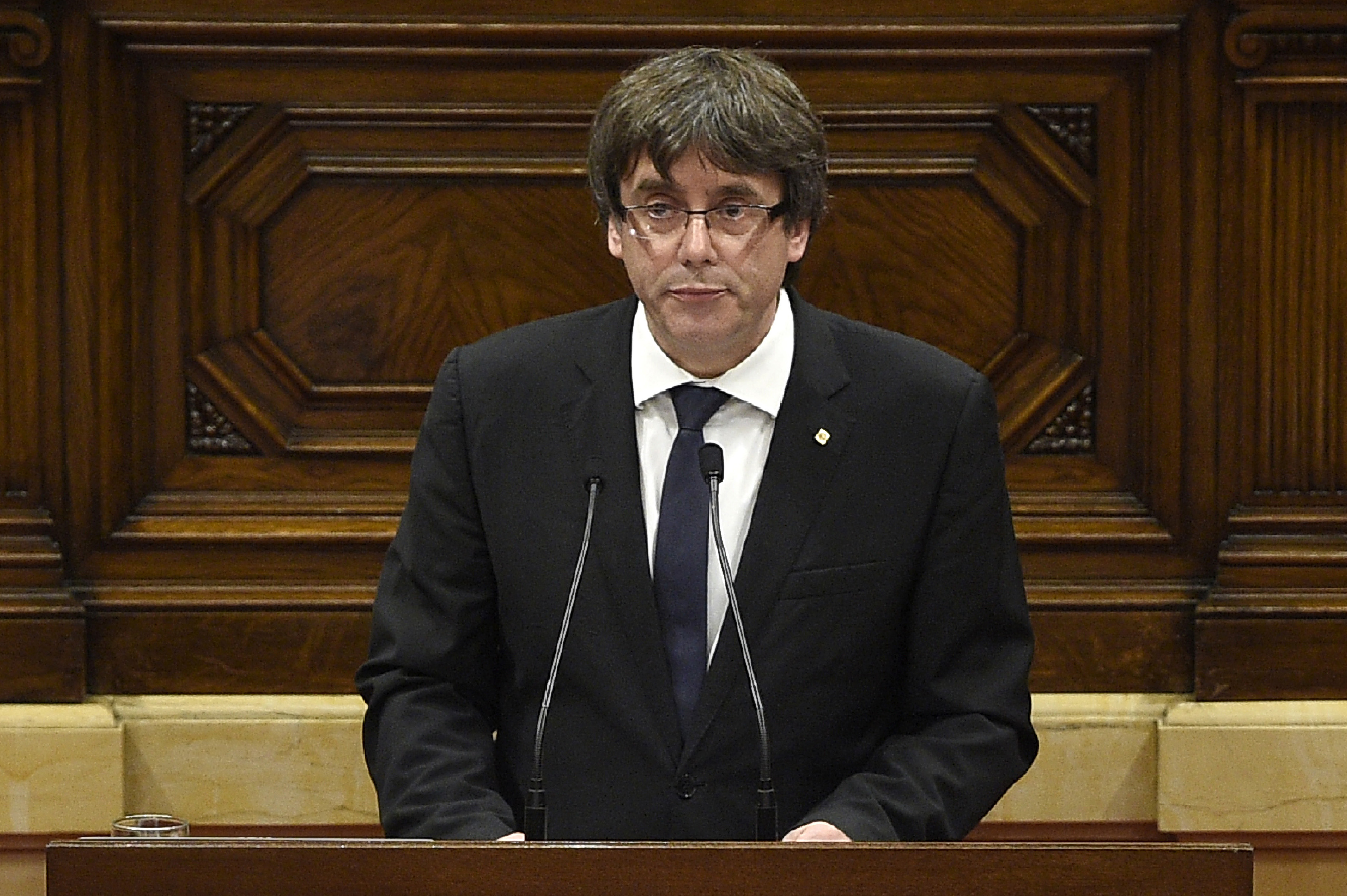 Catalan regional government president Carles Puigdemont gives a speech at the Catalan regional parliament in Barcelona, Oct. 10, 2017.