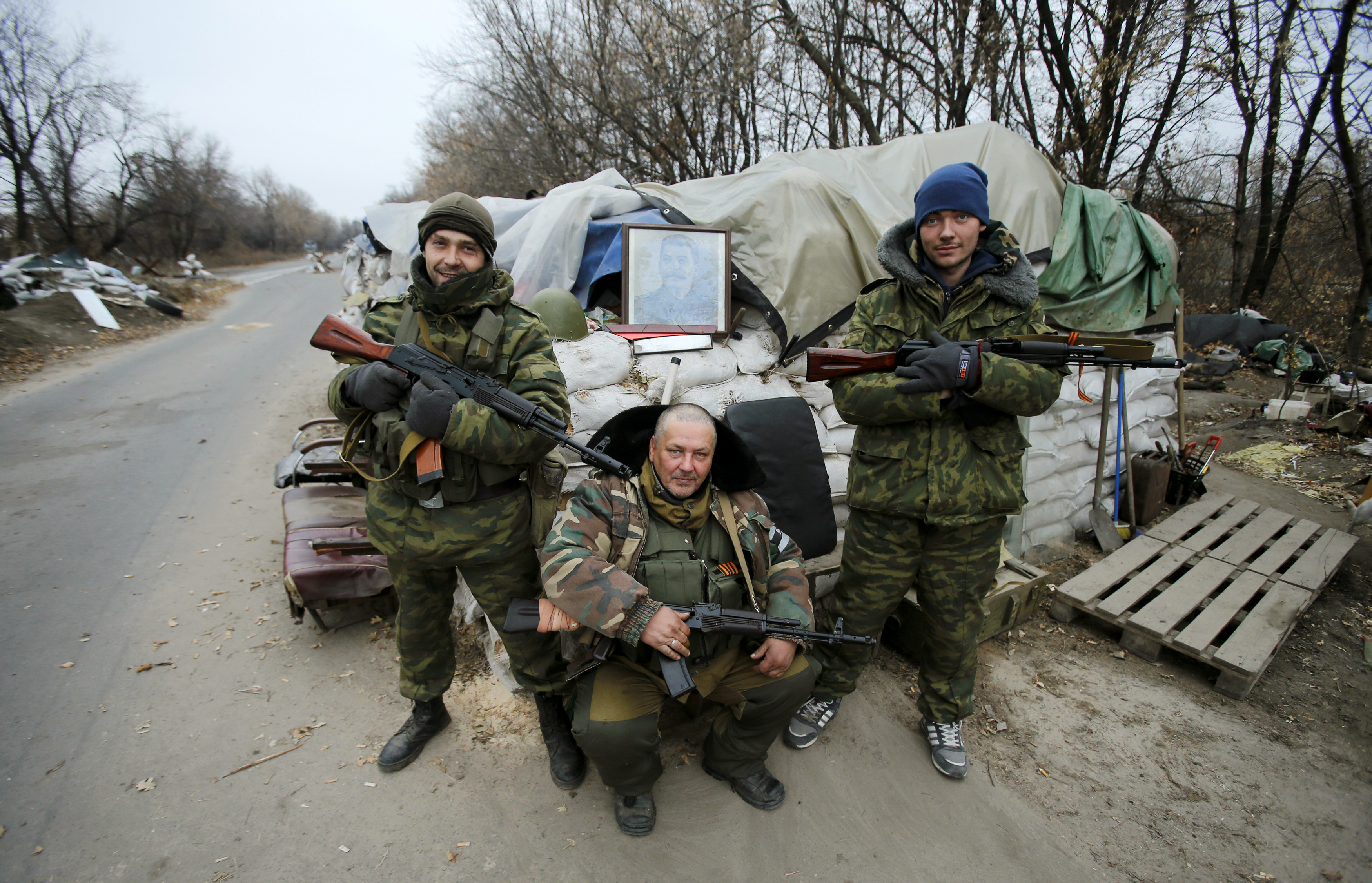 Pro-Russian separatists pose with a picture of Joseph Stalin at checkpoint in the Spartak area near the Sergey Prokofiev International Airport in Donetsk, Nov. 18, 2014.