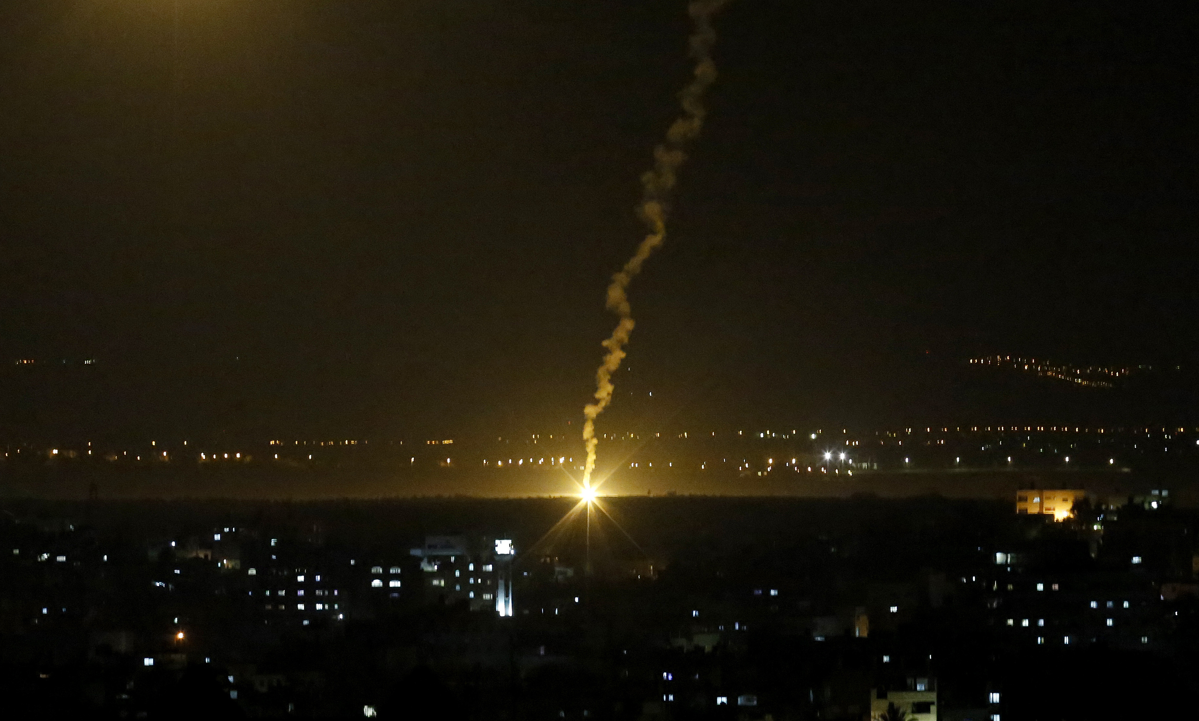 "Flares fired from Israeli forces light up the night sky in Gaza City, Nov. 12, 2018, as the Israeli military launched fighter jets to strike ""terror targets"" throughout the Gaza Strip."