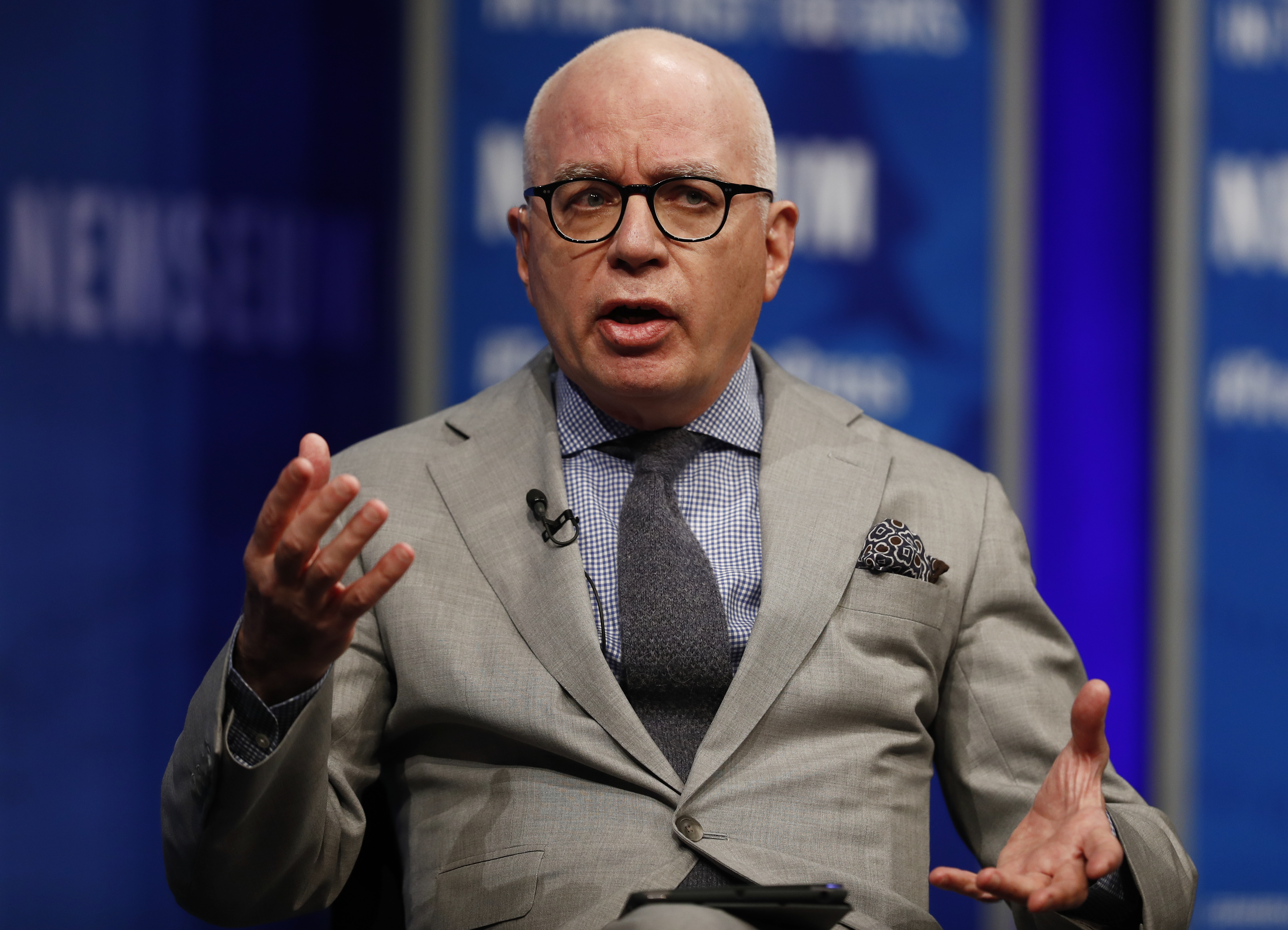 "FILE - Author Michael Wolff is pictured at the Newseum in Washington, April 12, 2017, as he moderates a conversation with presidential counselor Kellyanne Conway during a forum titled ""The President and the Press: The First Amendment in the First 100"