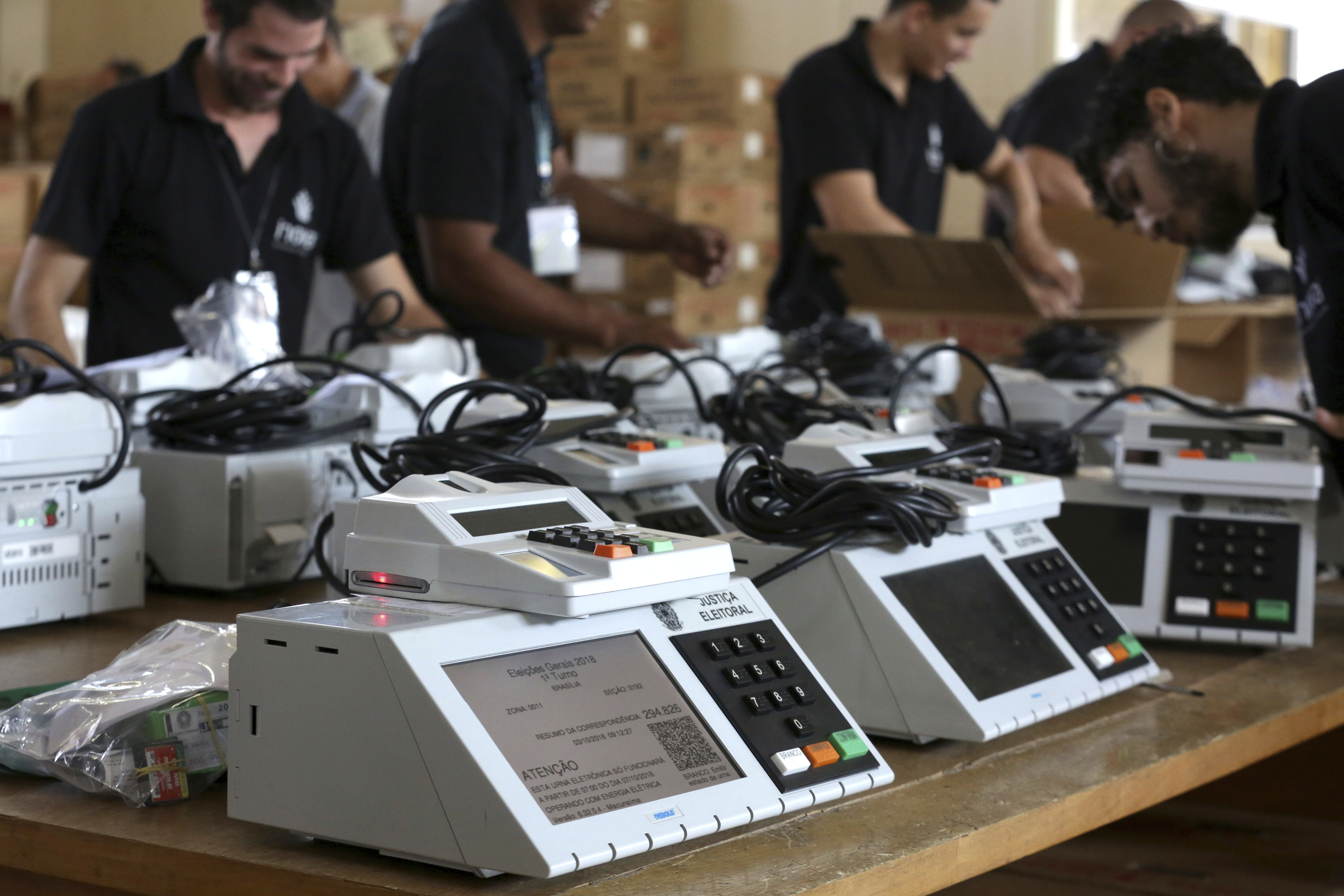Employees of the Regional Electoral Tribunal work on preparing voting machines in Brasilia, Brazil, Oct. 3, 2018. Brazilian will hold general elections on Oct. 7.