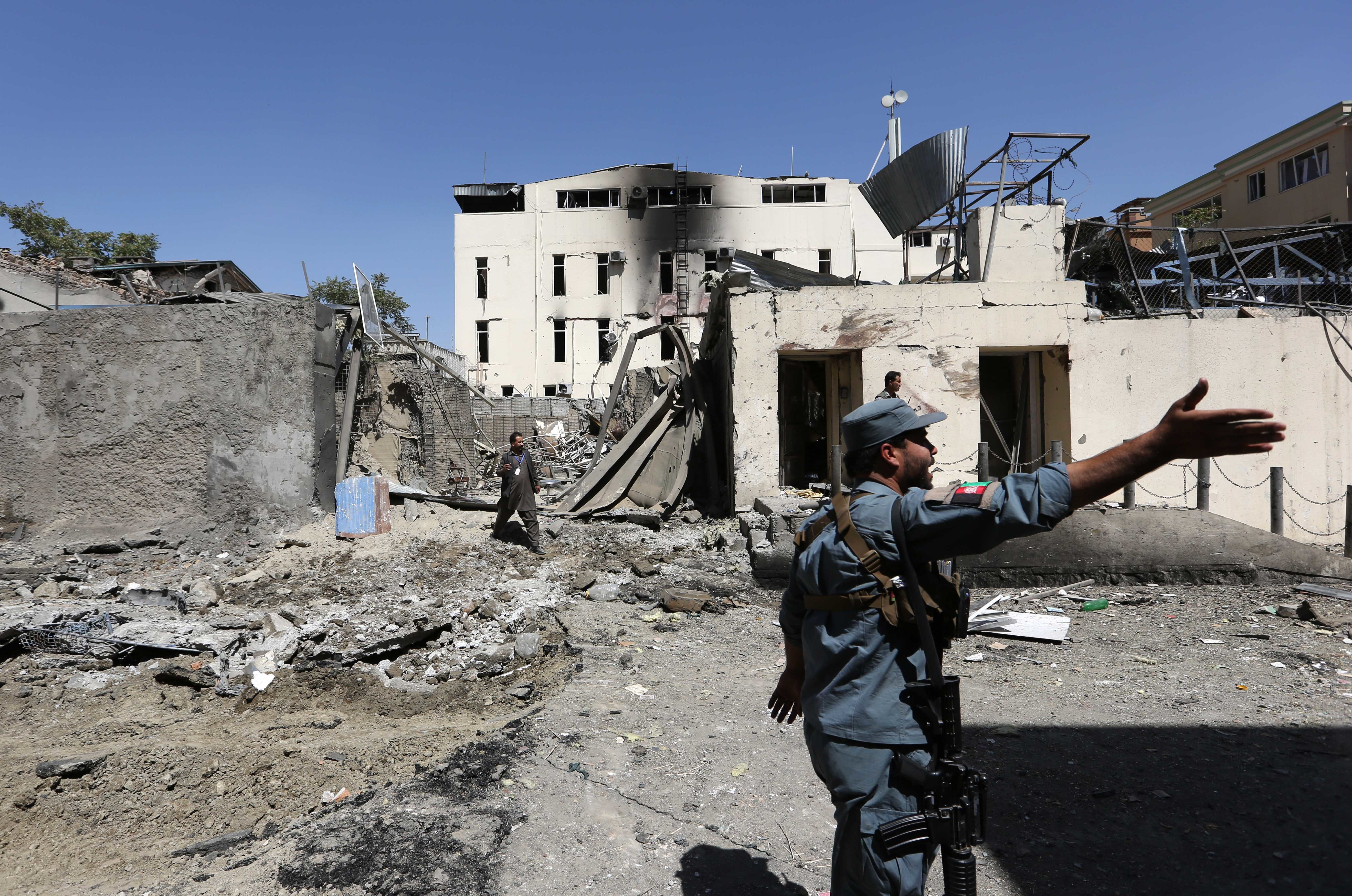 Afghan security forces inspect at the site of suicide attack in Kabul, Afghanistan, Sept. 6, 2016.